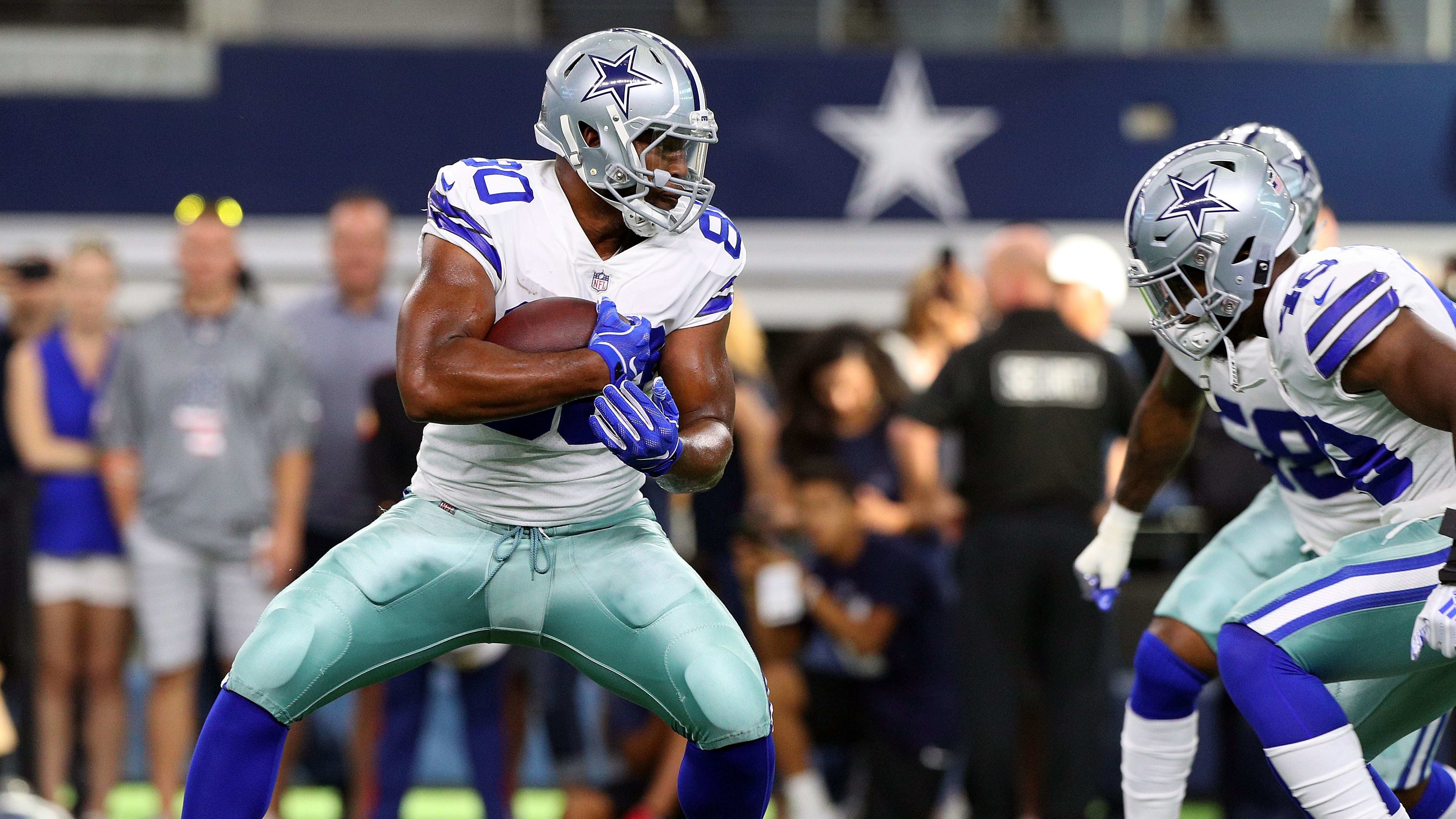 ARLINGTON, TX - AUGUST 26:  Rico Gathers #80 of the Dallas Cowboys warms up before the preseason game against the Arizona Cardinals at AT&T Stadium on August 26, 2018 in Arlington, Texas.  (Photo by Richard Rodriguez/Getty Images)
