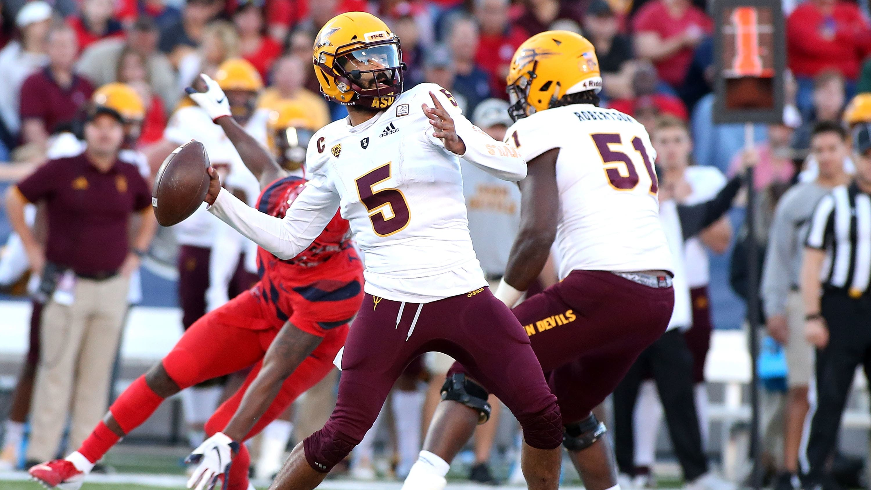 TUCSON, AZ - NOVEMBER 24:  Quarterback Manny Wilkins #5 of the Arizona State Sun Devils throws a pass against the Arizona Wildcats during the second half of the college football game at Arizona Stadium on November 24, 2018 in Tucson, Arizona.  (Photo by Ralph Freso/Getty Images)