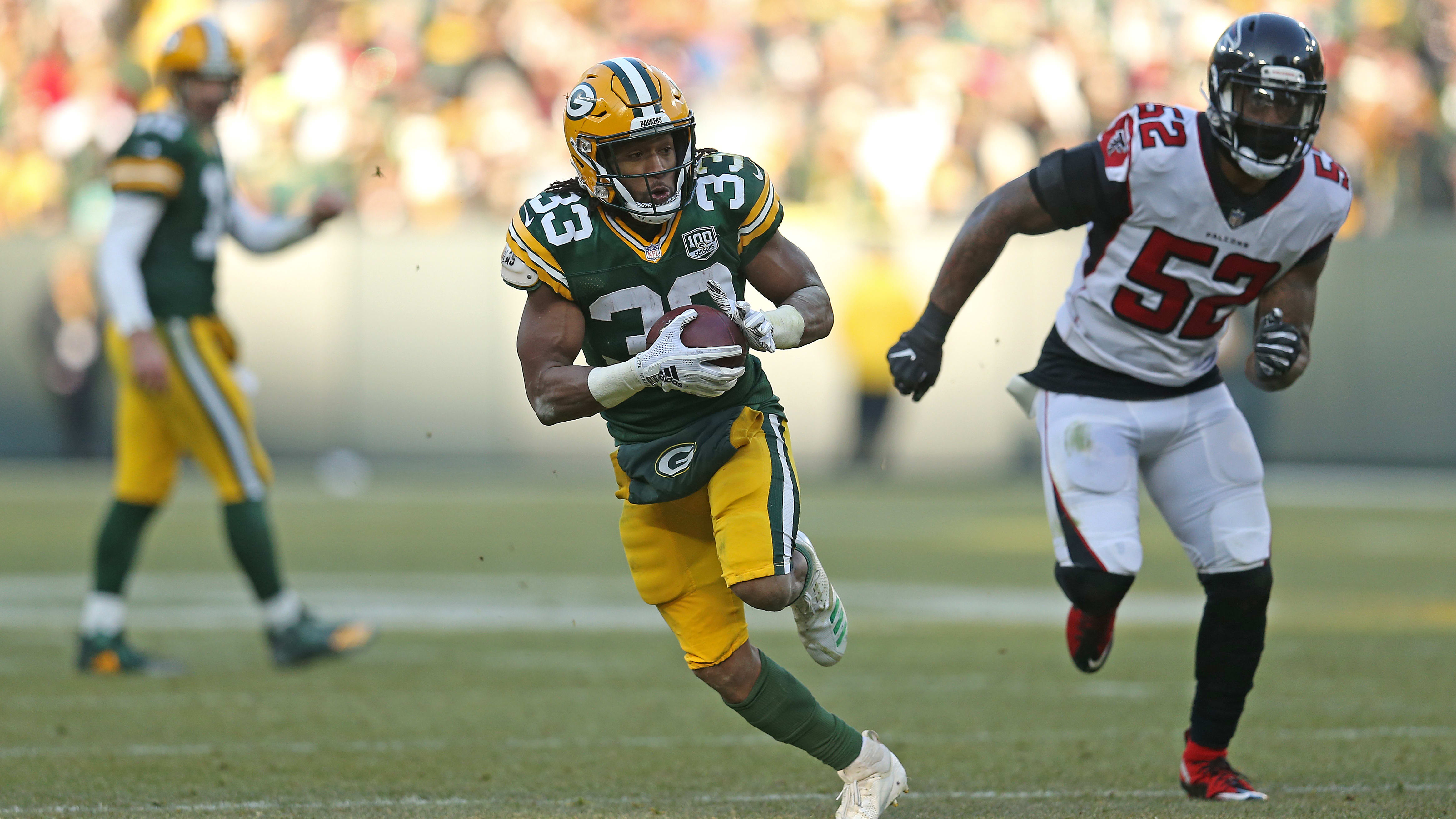 GREEN BAY, WISCONSIN - DECEMBER 09: Aaron Jones #33 of the Green Bay Packers runs the ball for a touchdown during the second half of a game against the Atlanta Falcons at Lambeau Field on December 09, 2018 in Green Bay, Wisconsin. (Photo by Dylan Buell/Getty Images)