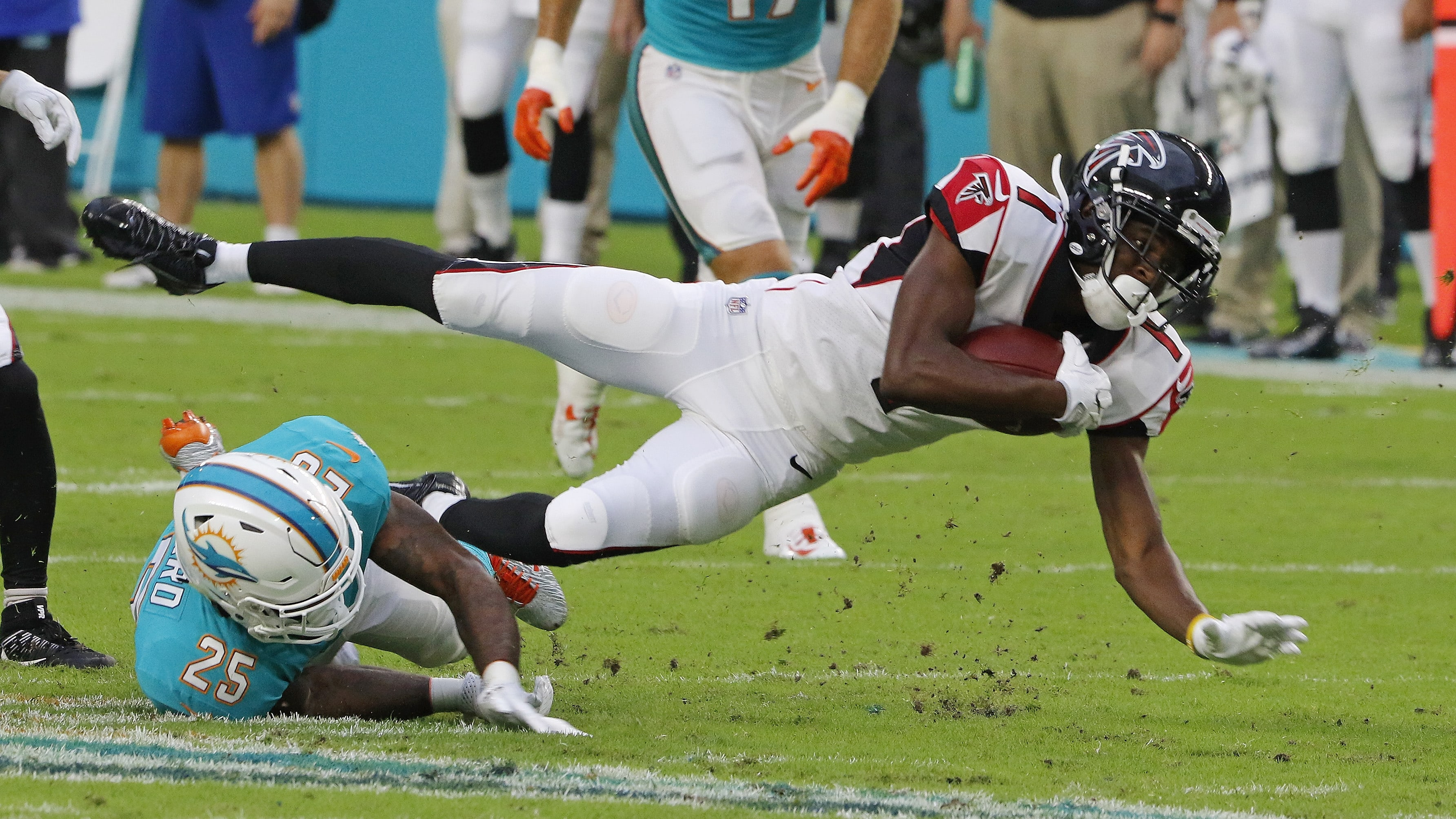 MIAMI GARDENS, FL - AUGUST 10:  Reggie Davis #1 of the Atlanta Falcons goes the turf after being hit by Xavien Howard #25 of the Miami Dolphins during their preseason game at Hard Rock Stadium on August 10, 2017 in Miami Gardens, Florida.  (Photo by Joe Skipper/Getty Images)