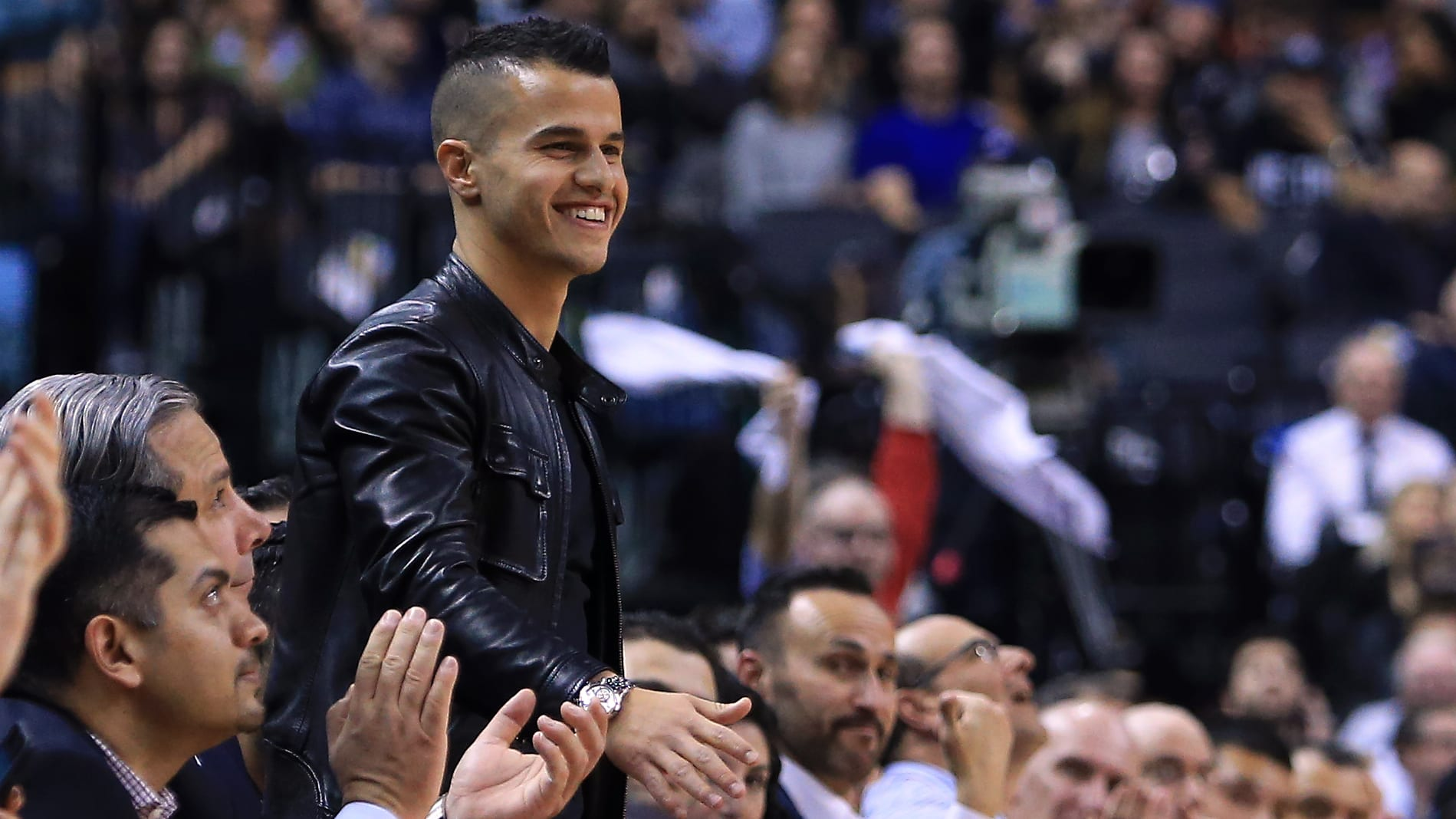 TORONTO, ON - MARCH 30:  Toronto FC soccer player Sebastian Giovinco smiles from his courtside seat during the first half of an NBA game between the Atlanta Hawks and the Toronto Raptors at the Air Canada Centre on March 30, 2016 in Toronto, Ontario, Canada.  NOTE TO USER: User expressly acknowledges and agrees that, by downloading and or using this photograph, User is consenting to the terms and conditions of the Getty Images License Agreement.  (Photo by Vaughn Ridley/Getty Images)