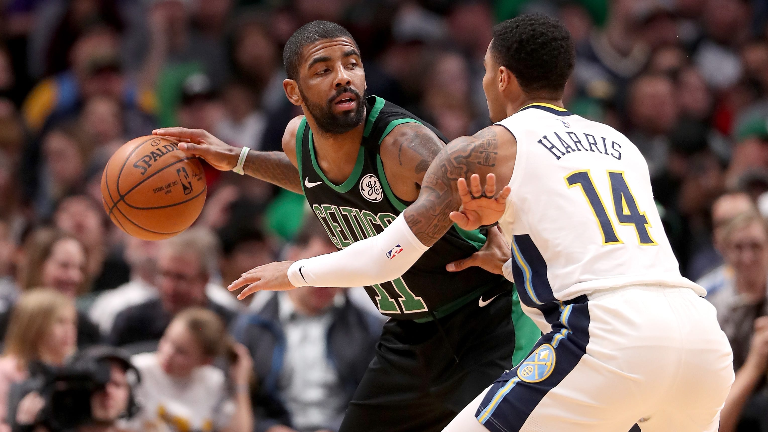 DENVER, CO - JANUARY 29:  Kyrie Irving #11 of the Boston Celtics is guarded by Gary Harris #14 of the Denver Nuggets at the Pepsi Center on January 29, 2018 in Denver, Colorado. NOTE TO USER: User expressly acknowledges and agrees that, by downloading and or using this photograph, User is consenting to the terms and conditions of the Getty Images License Agreement.  (Photo by Matthew Stockman/Getty Images)