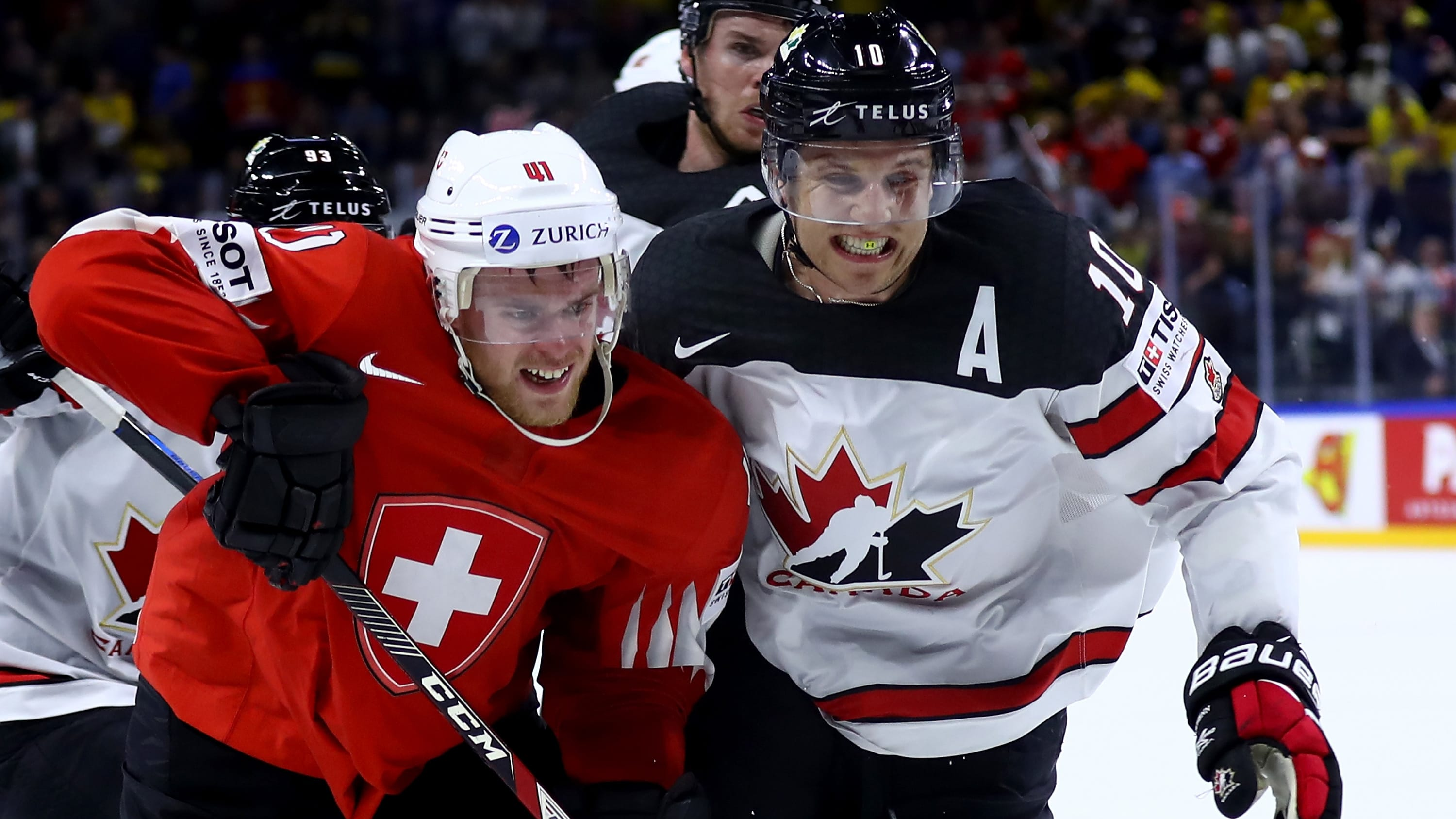 COPENHAGEN, DENMARK - MAY 19 :Bryaden Schenn #10 of Canada and Mirco Muller of Switzerland battle for position during the 2018 IIHF Ice Hockey World Championship Semi Final game between Canada and Switzerland at Royal Arena on May 19, 2018 in Copenhagen, Denmark. (Photo by Martin Rose/Getty Images)
