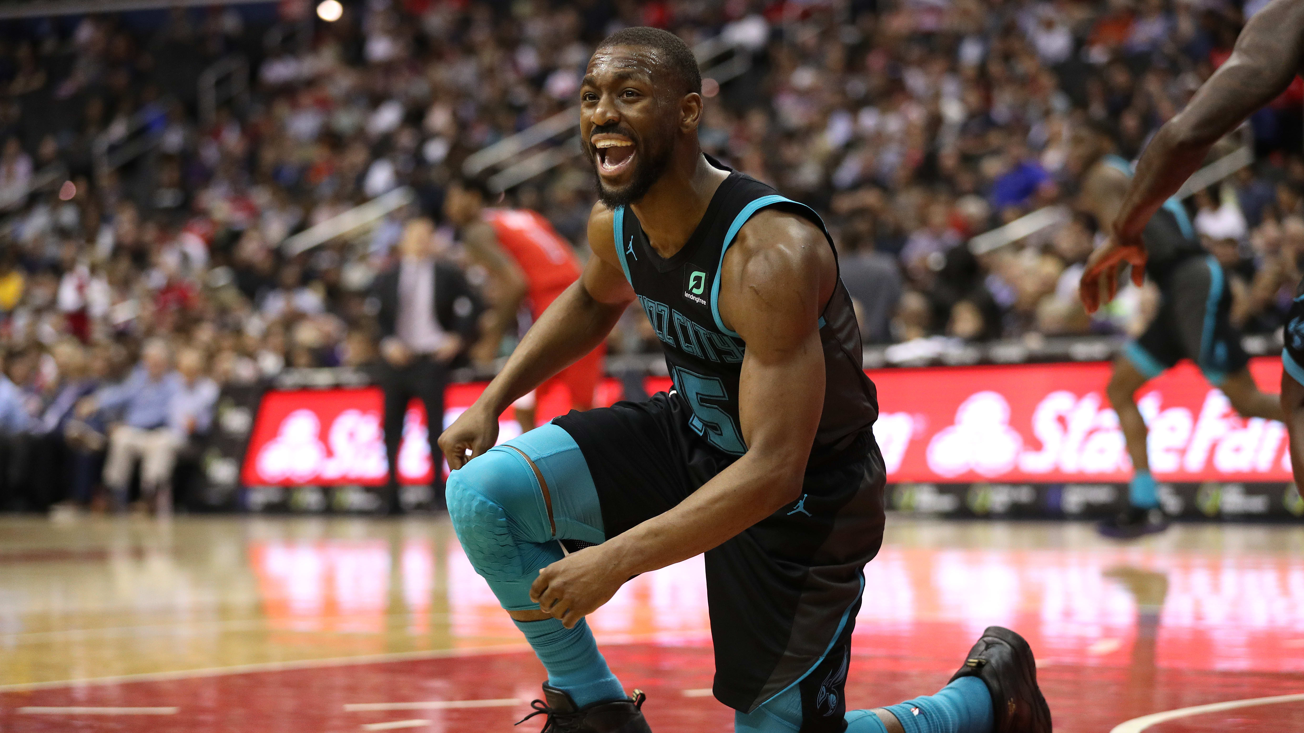 WASHINGTON, DC - MARCH 15: Kemba Walker #15 of the Charlotte Hornets reacts against the Washington Wizards during the first half at Capital One Arena on March 15, 2019 in Washington, DC. NOTE TO USER: User expressly acknowledges and agrees that, by downloading and or using this photograph, User is consenting to the terms and conditions of the Getty Images License Agreement. (Photo by Patrick Smith/Getty Images)