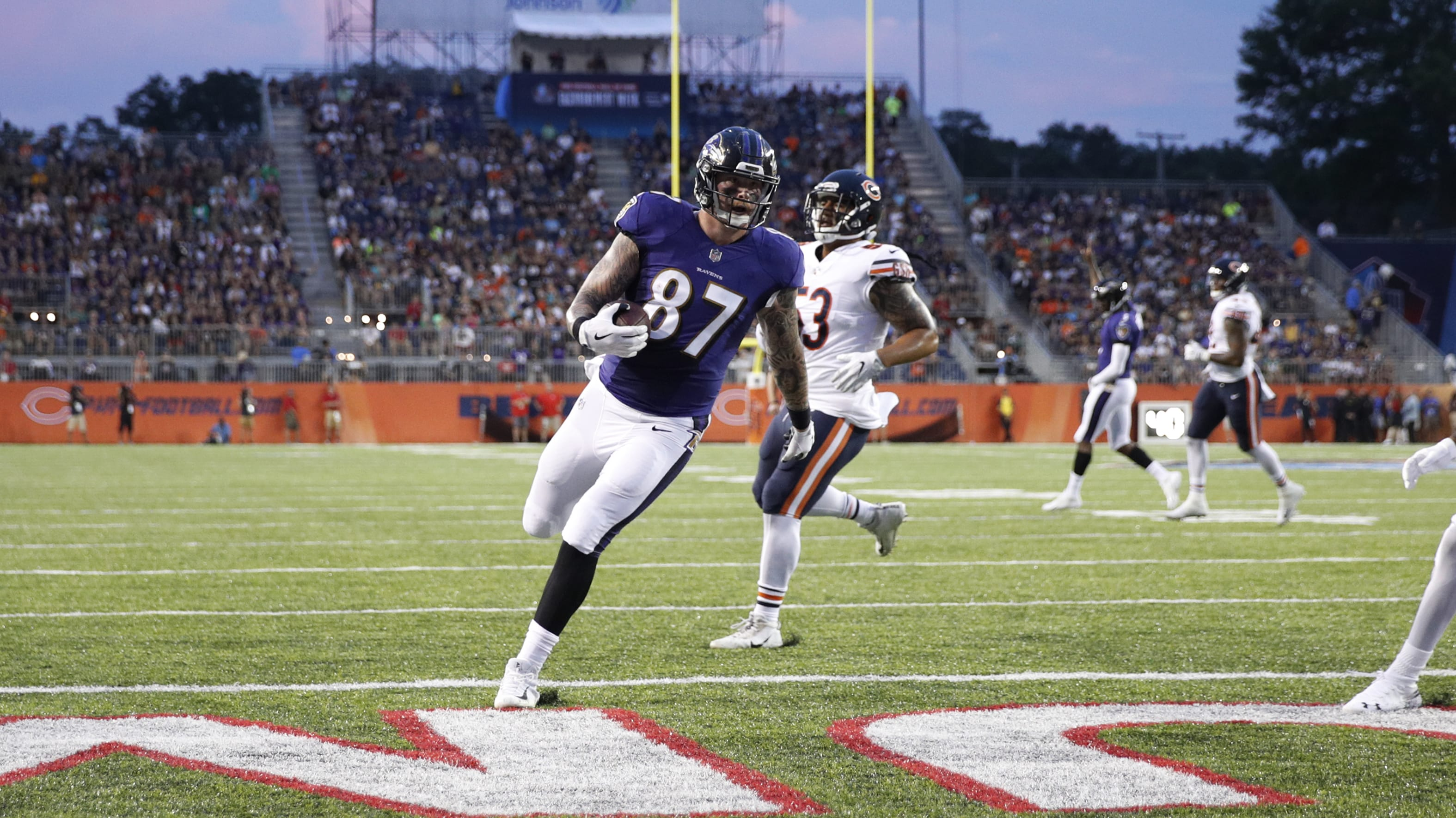 CANTON, OH - AUGUST 02: Maxx Williams #87 of the Baltimore Ravens runs into the end zone with a five-yard touchdown reception in the first quarter of the Hall of Fame Game against the Chicago Bears at Tom Benson Hall of Fame Stadium on August 2, 2018 in Canton, Ohio. (Photo by Joe Robbins/Getty Images)