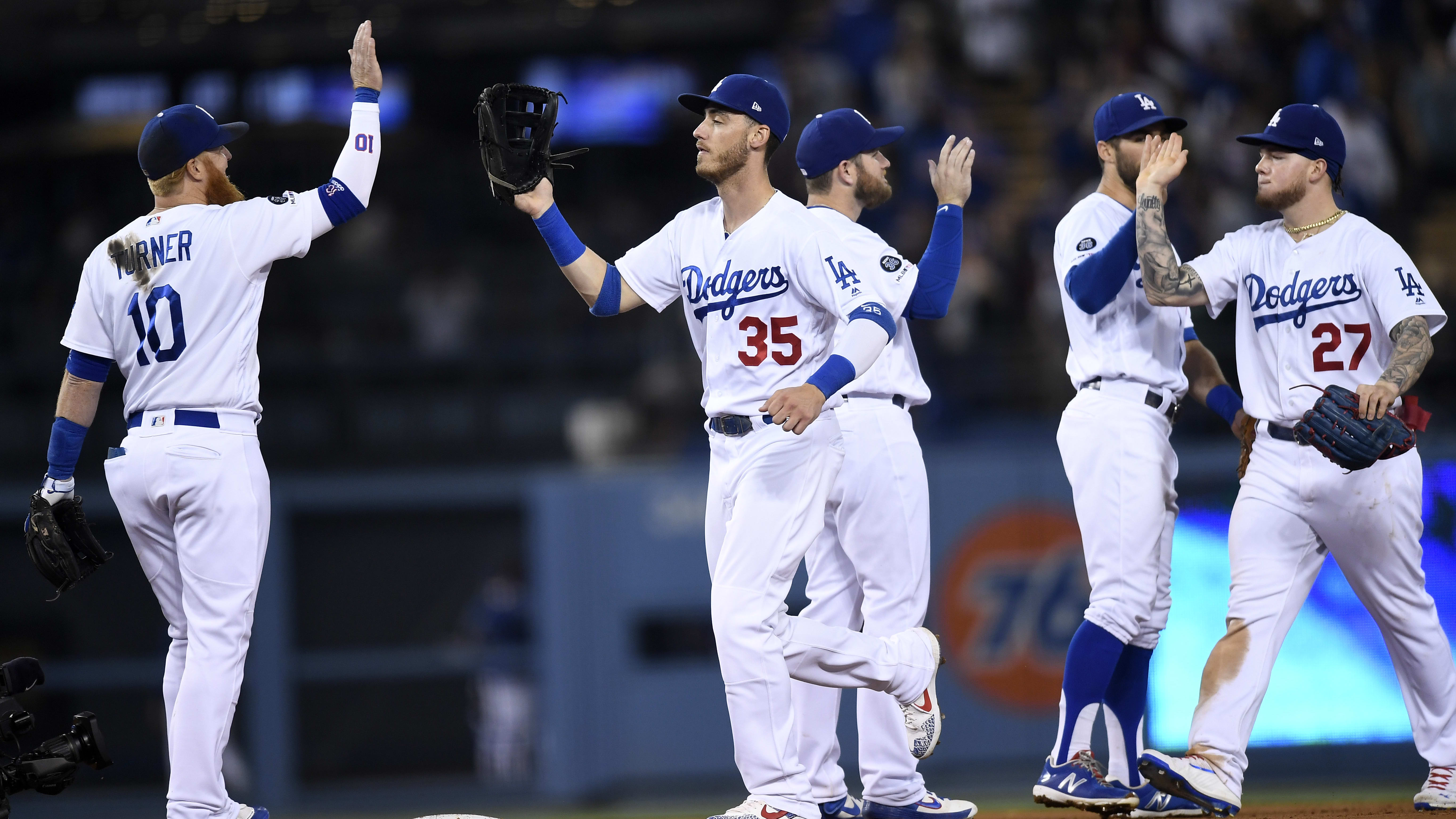 LOS ANGELES, CA - JUNE 13: Cody Bellinger #35 of the Los Angeles Dodgers celebrates with teammates after defeating Chicago Cubs, 7-3, at Dodger Stadium on June 13, 2019 in Los Angeles, California. (Photo by Kevork Djansezian/Getty Images)