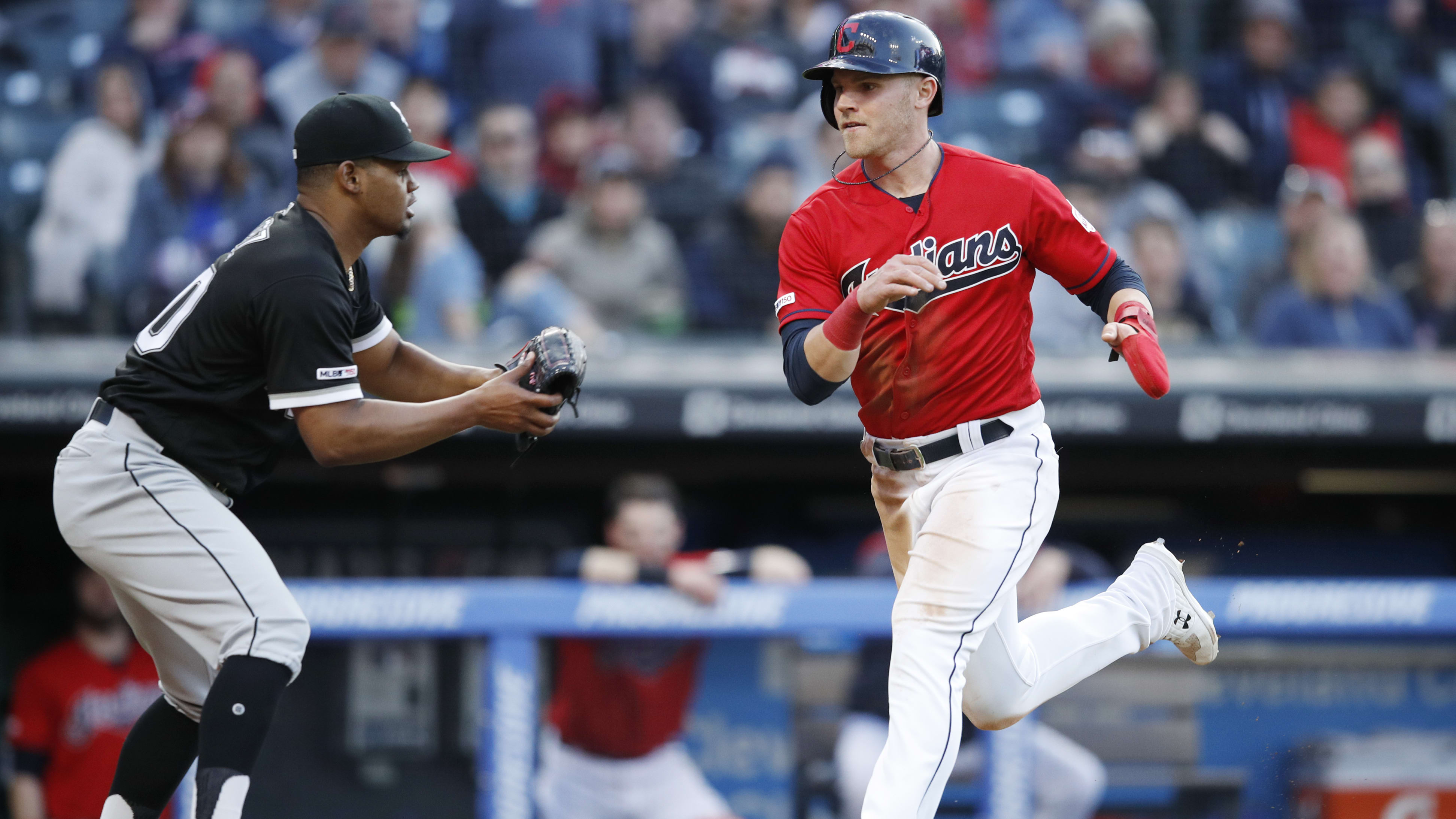 CLEVELAND, OH - MAY 08: Jake Bauers #10 of the Cleveland Indians gets tagged out trying to score in the sixth inning by Reynaldo Lopez #40 of the Chicago White Sox at Progressive Field on May 8, 2019 in Cleveland, Ohio. The Indians won 5-3. (Photo by Joe Robbins/Getty Images)