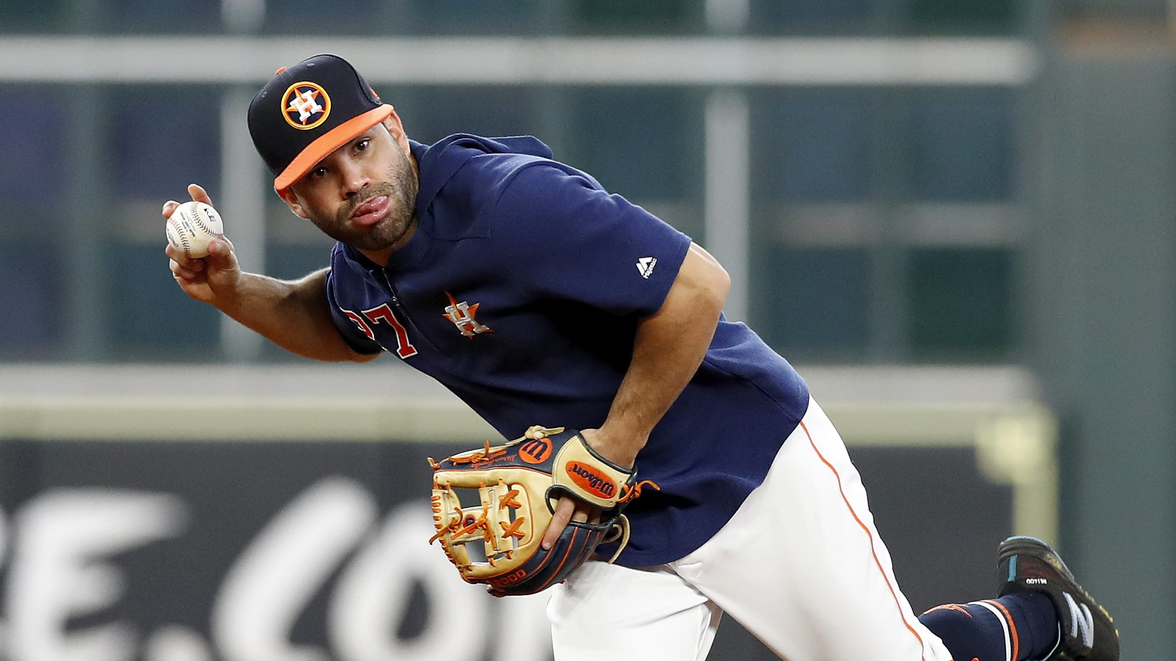HOUSTON, TX - MAY 23:  Jose Altuve #27 of the Houston Astros fields ground balls before the game against the Chicago White Sox at Minute Maid Park on May 23, 2019 in Houston, Texas.  (Photo by Tim Warner/Getty Images)