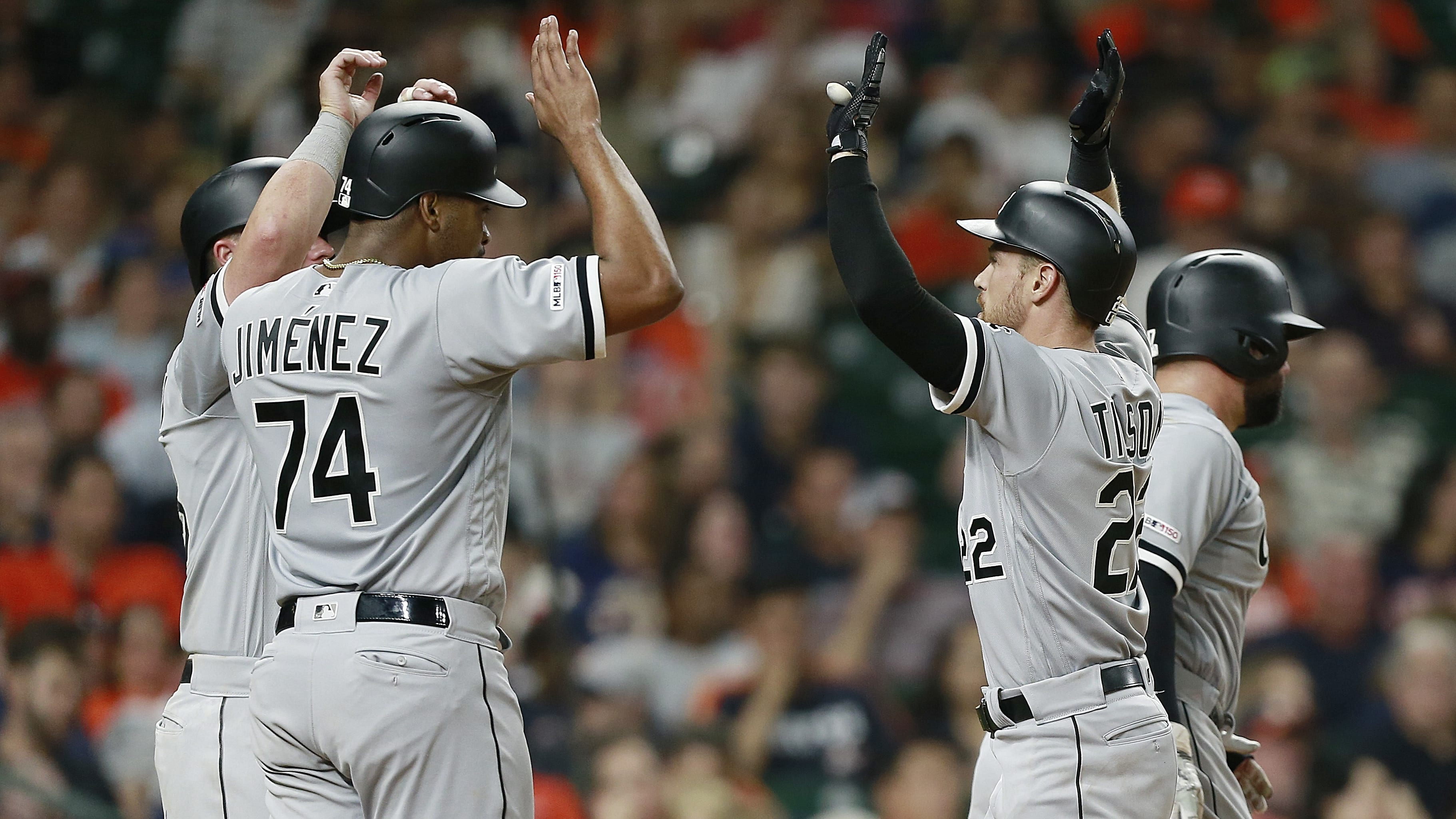 HOUSTON, TEXAS - MAY 22: Charlie Tilson #22 of the Chicago White Sox is congratulated at home plate by Eloy Jimenez #74, James McCann #33 and Yonder Alonso #17 after hitting a grand slam in the sixth inning against the Houston Astros at Minute Maid Park on May 22, 2019 in Houston, Texas. (Photo by Bob Levey/Getty Images)