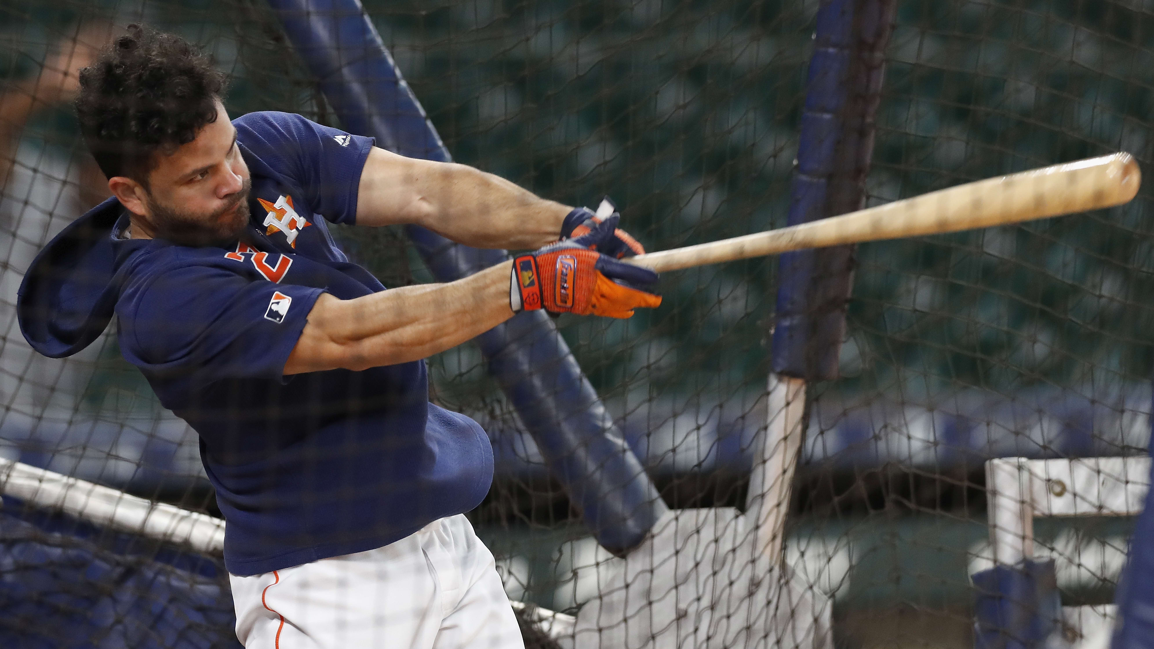 HOUSTON, TX - MAY 23:  Jose Altuve #27 of the Houston Astros takes batting practice before the game against the Chicago White Sox at Minute Maid Park on May 23, 2019 in Houston, Texas.  (Photo by Tim Warner/Getty Images)