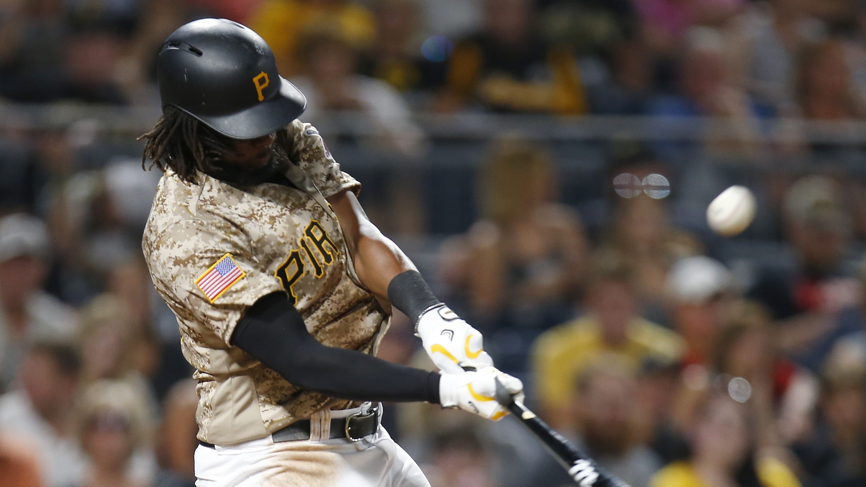 PITTSBURGH, PA - AUGUST 03:  Josh Bell #55 of the Pittsburgh Pirates hits a sacrifice fly in the seventh inning against the Cincinnati Reds at PNC Park on August 3, 2017 in Pittsburgh, Pennsylvania.  (Photo by Justin K. Aller/Getty Images)