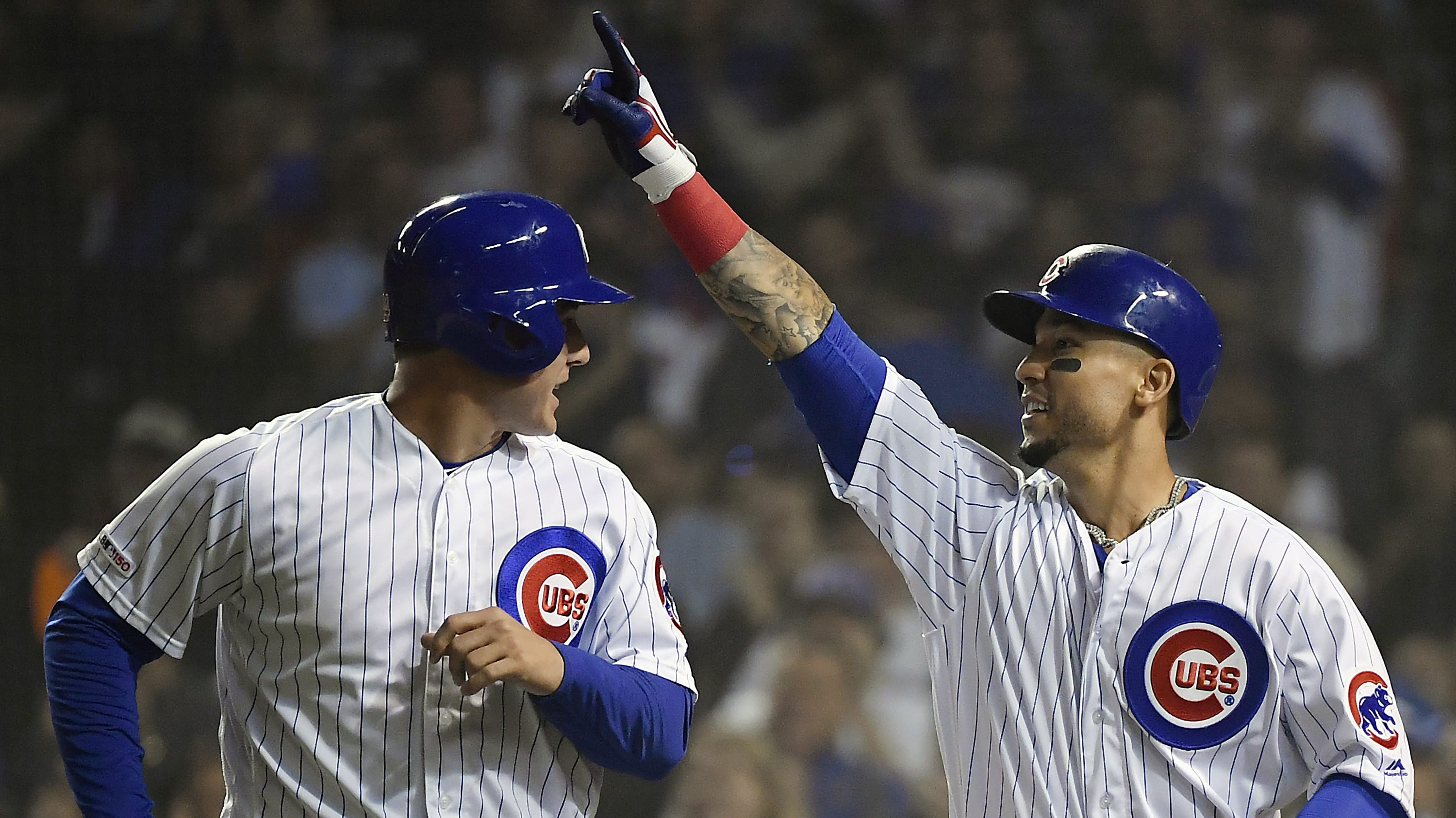CHICAGO, ILLINOIS - JUNE 05: Carlos Gonzalez #2 of the Chicago Cubs and Anthony Rizzo #44 of the Chicago Cubs celebrate after scoring in the sixth inning against the Colorado Rockies at Wrigley Field on June 05, 2019 in Chicago, Illinois. (Photo by Quinn Harris/Getty Images)