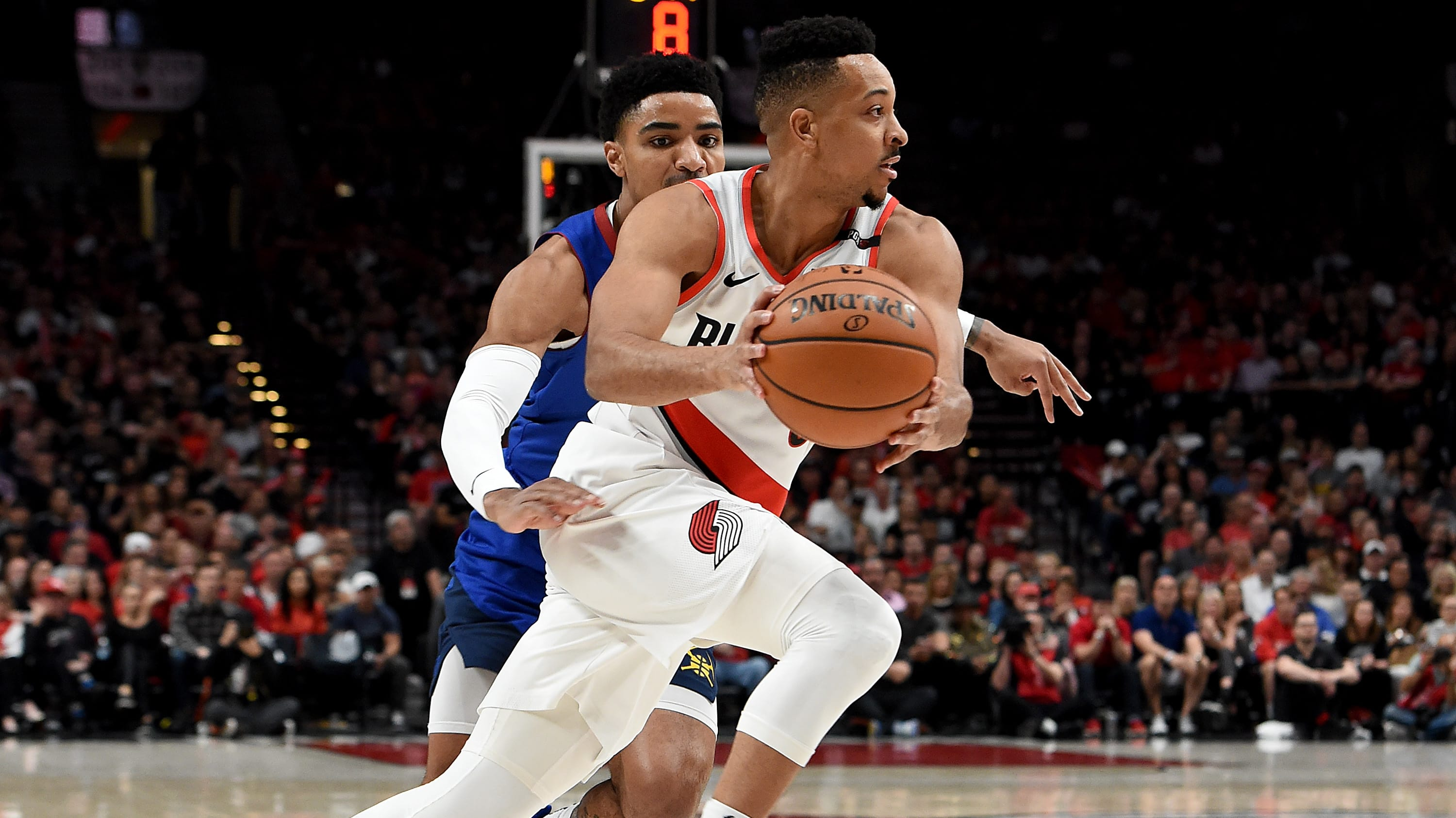 PORTLAND, OREGON - MAY 09: CJ McCollum #3 of the Portland Trail Blazers drives to the basket past Gary Harris #14 of the Denver Nuggets during the second half of Game Six of the Western Conference Semifinals at Moda Center on May 09, 2019 in Portland, Oregon. The Blazers won 119-108. NOTE TO USER: User expressly acknowledges and agrees that, by downloading and or using this photograph, User is consenting to the terms and conditions of the Getty Images License Agreement. (Photo by Steve Dykes/Getty Images)