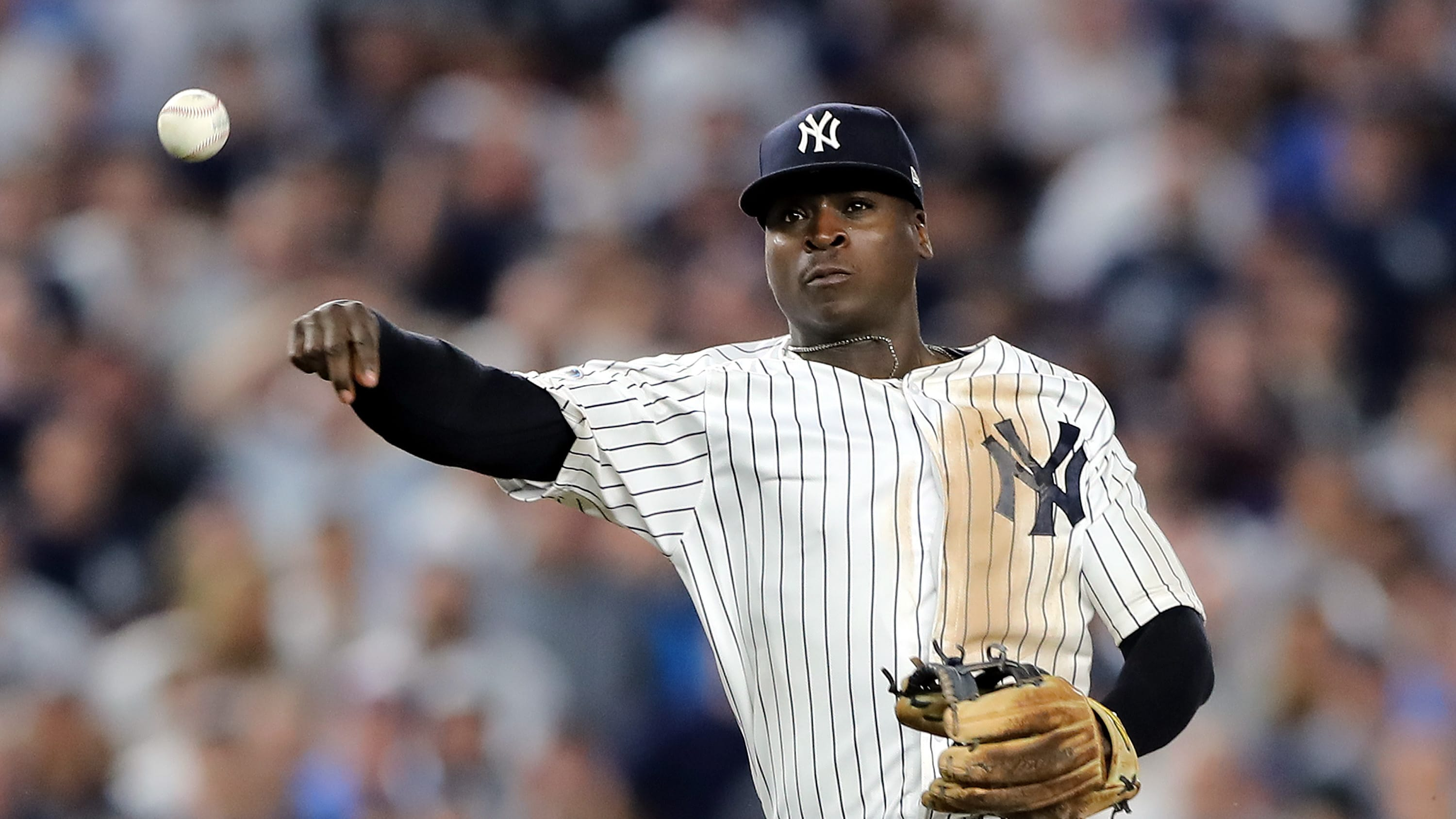 NEW YORK, NEW YORK - OCTOBER 09:   Didi Gregorius #18 of the New York Yankees throws to first base against the Boston Red Sox during Game Four American League Division Series at Yankee Stadium on October 09, 2018 in the Bronx borough of New York City. (Photo by Elsa/Getty Images)