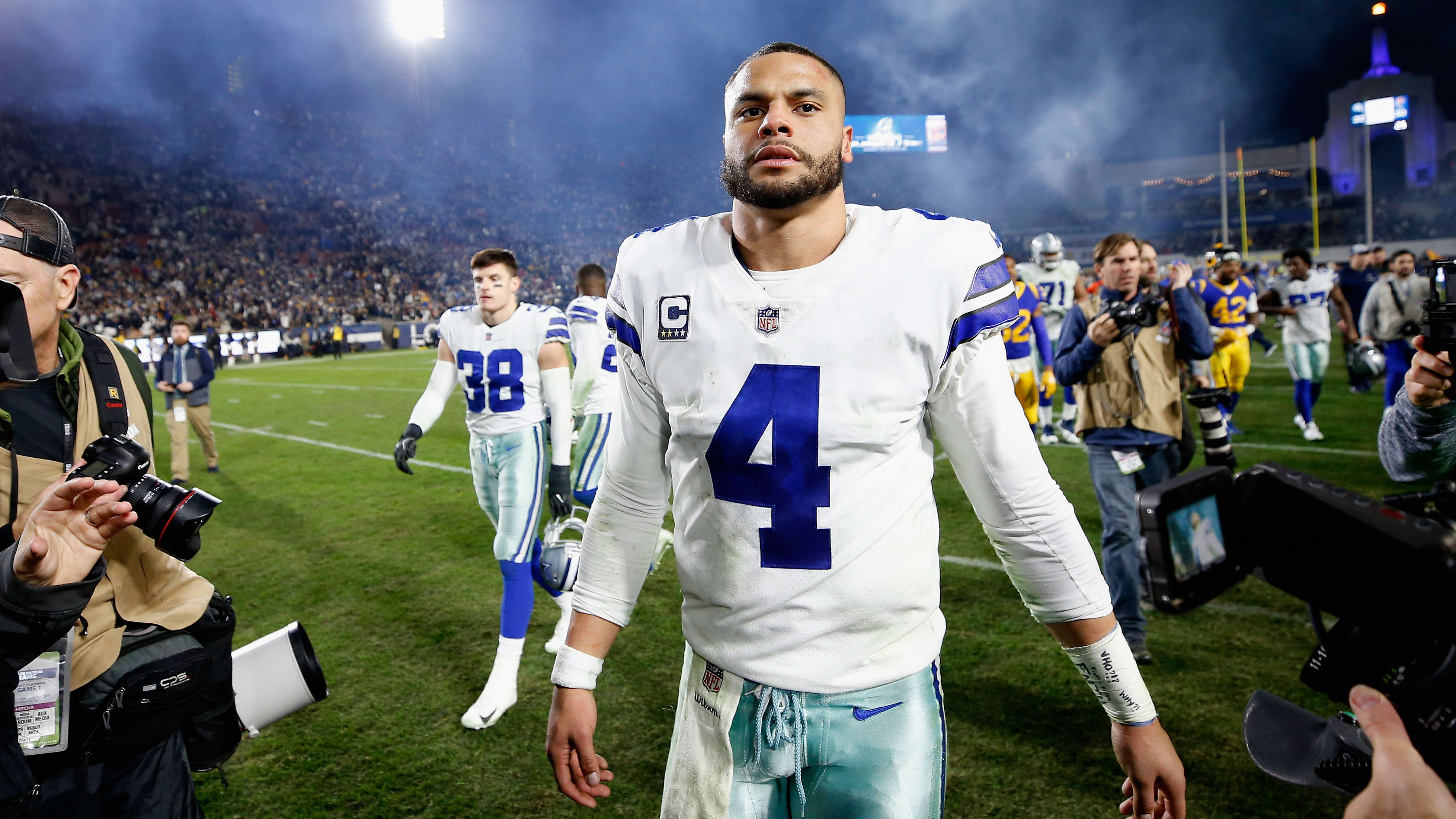 LOS ANGELES, CA - JANUARY 12:  Dak Prescott #4 of the Dallas Cowboys walks off the field after the NFC Divisional Playoff game against the Los Angeles Lakers at Los Angeles Memorial Coliseum on January 12, 2019 in Los Angeles, California. The Rams defeated the Cowboys 30-22.  (Photo by Sean M. Haffey/Getty Images)