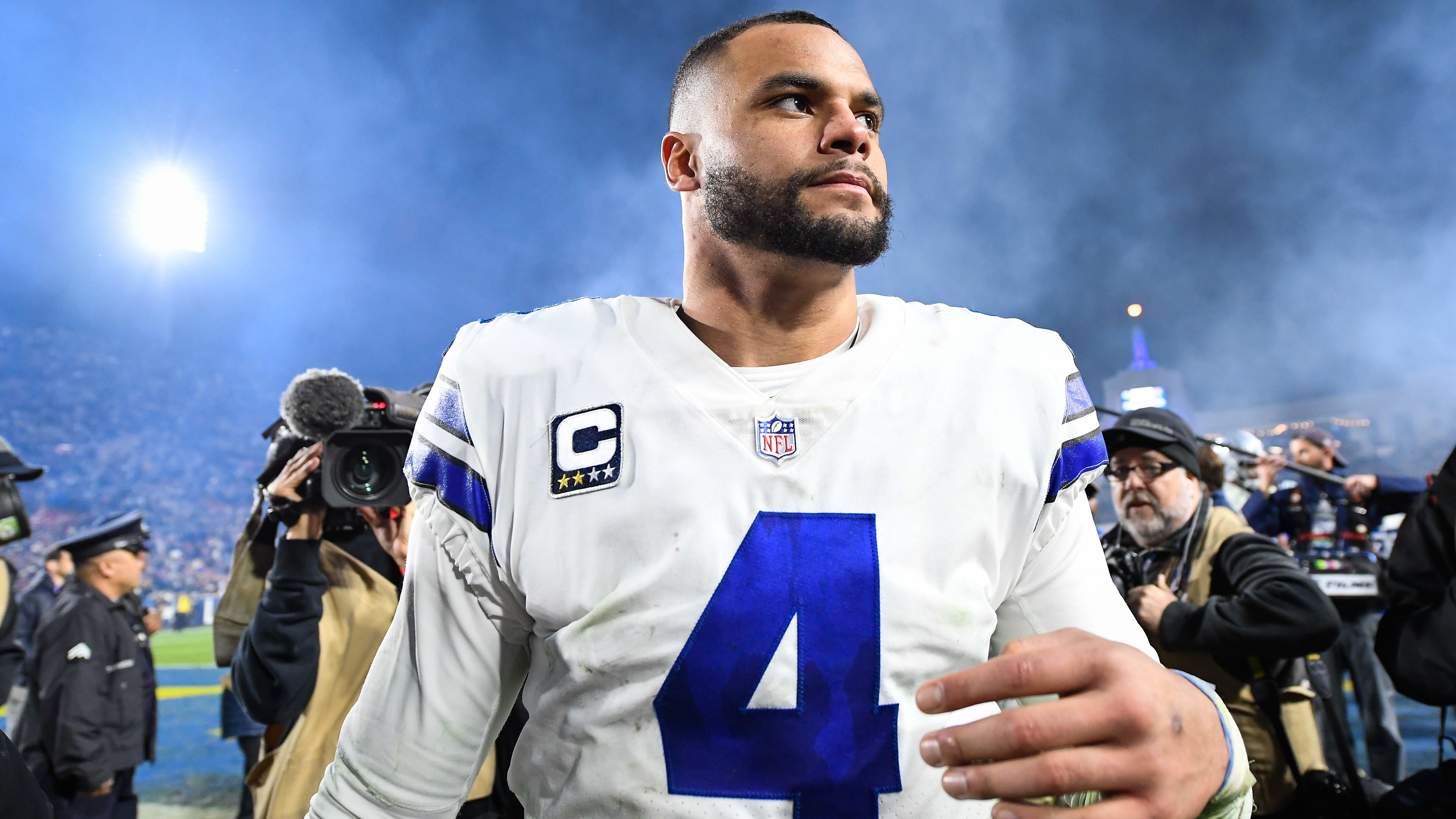 LOS ANGELES, CA - JANUARY 12: Quarterback Dak Prescott #4 of the Dallas Cowboys walks off the field after losing the NFC Divisional Round playoff game to the Los Angeles Rams at Los Angeles Memorial Coliseum on January 12, 2019 in Los Angeles, California. (Photo by Kevork Djansezian/Getty Images)