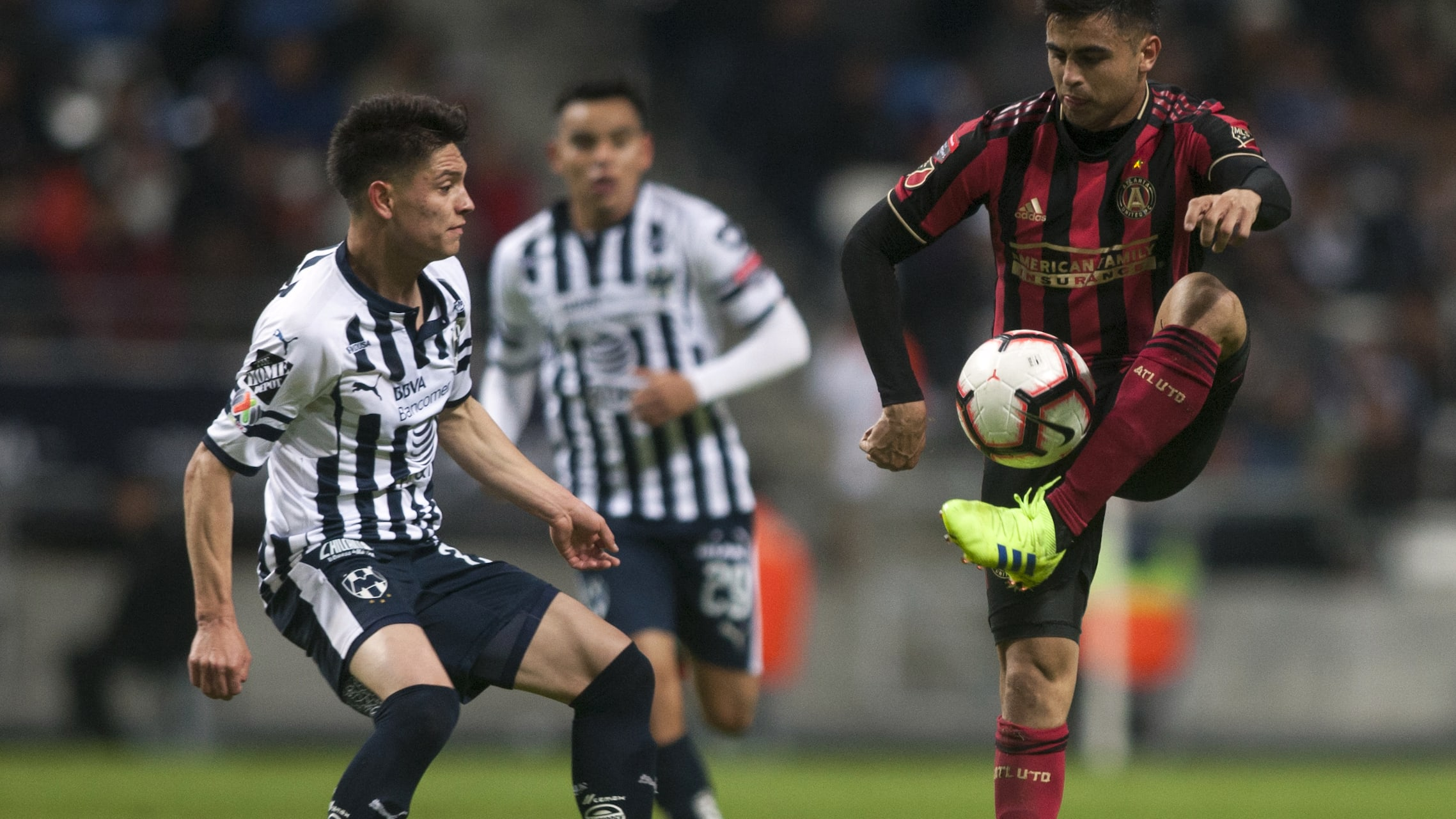 Jonathan Gonzalez (L) of Mexico's Monterrey vies for the ball with Gonzalo Martinez of US United Atlanta FC during the first leg quarterfinal football match of the CONCACAF Champions League at the BBVA Bancomer stadium in Monterrey, Mexico, on March 6, 2019. (Photo by Julio Cesar AGUILAR / AFP)        (Photo credit should read JULIO CESAR AGUILAR/AFP/Getty Images)