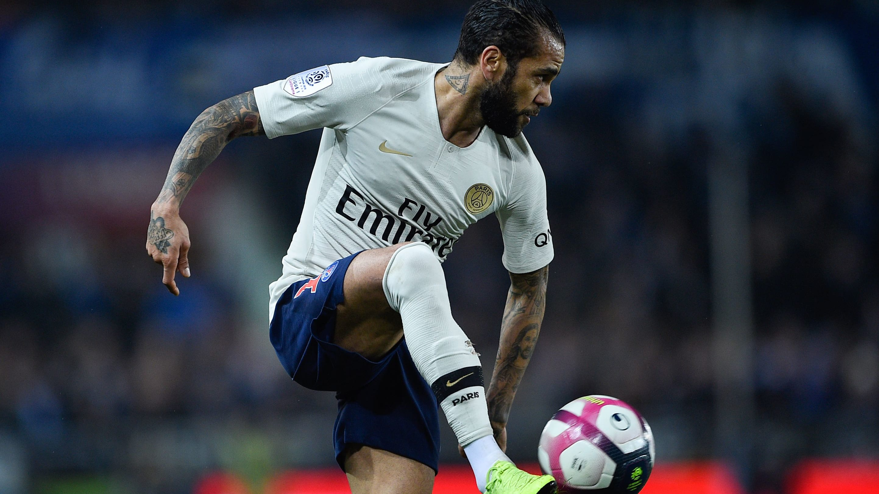 Paris Saint-Germain's Brazilian defender Dani Alves controls the ball during the French L1 football match between Strasbourg and Paris Saint-Germain (PSG) at the Stade de la Meinau stadium, in Strasbourg, on December 5, 2018. (Photo by JEAN-CHRISTOPHE VERHAEGEN / AFP)        (Photo credit should read JEAN-CHRISTOPHE VERHAEGEN/AFP/Getty Images)