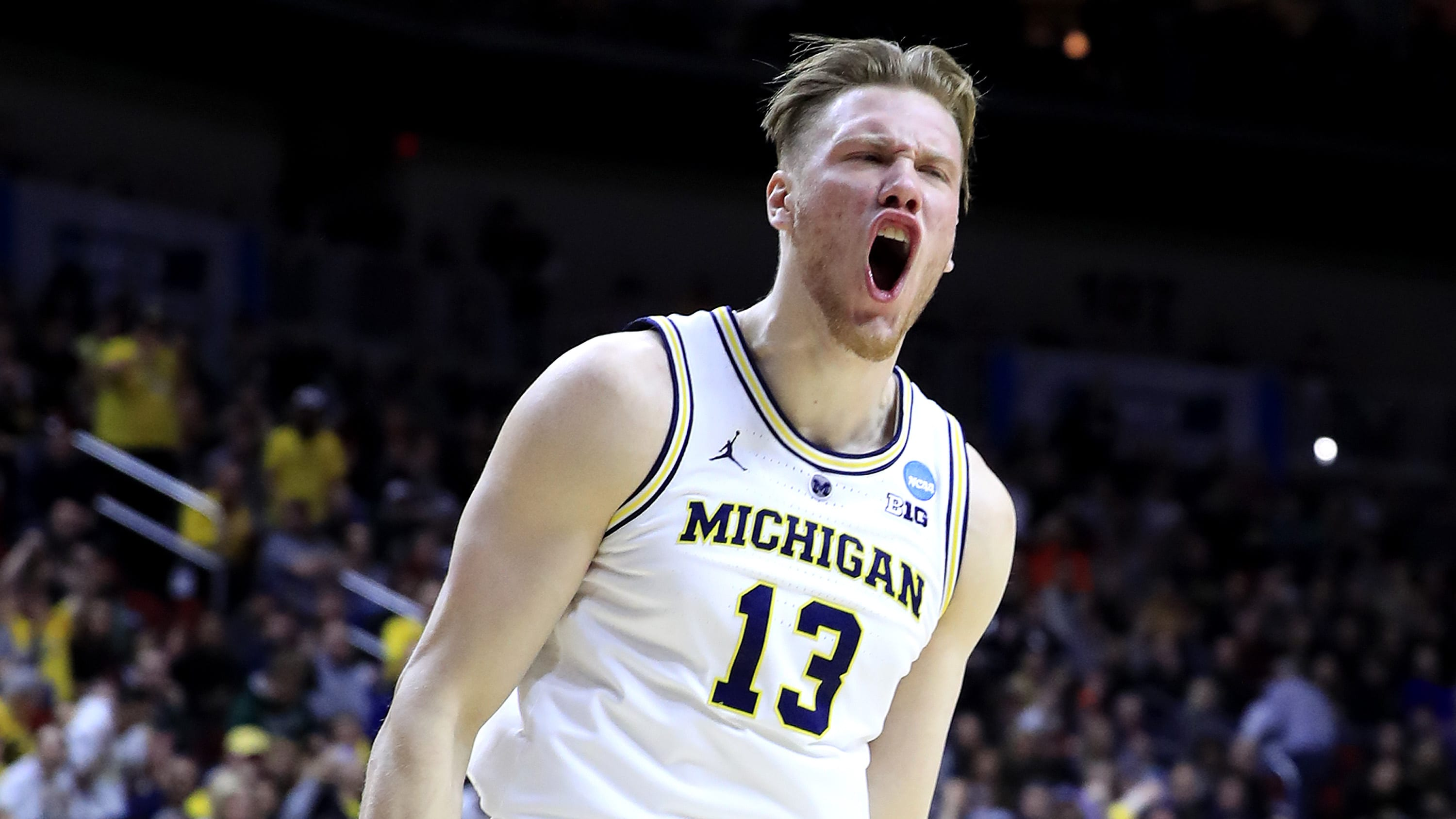 DES MOINES, IOWA - MARCH 23: Ignas Brazdeikis #13 of the Michigan Wolverines reacts after a dunk against the Florida Gators during the first half in the second round game of the 2019 NCAA Men's Basketball Tournament at Wells Fargo Arena on March 23, 2019 in Des Moines, Iowa. (Photo by Andy Lyons/Getty Images)