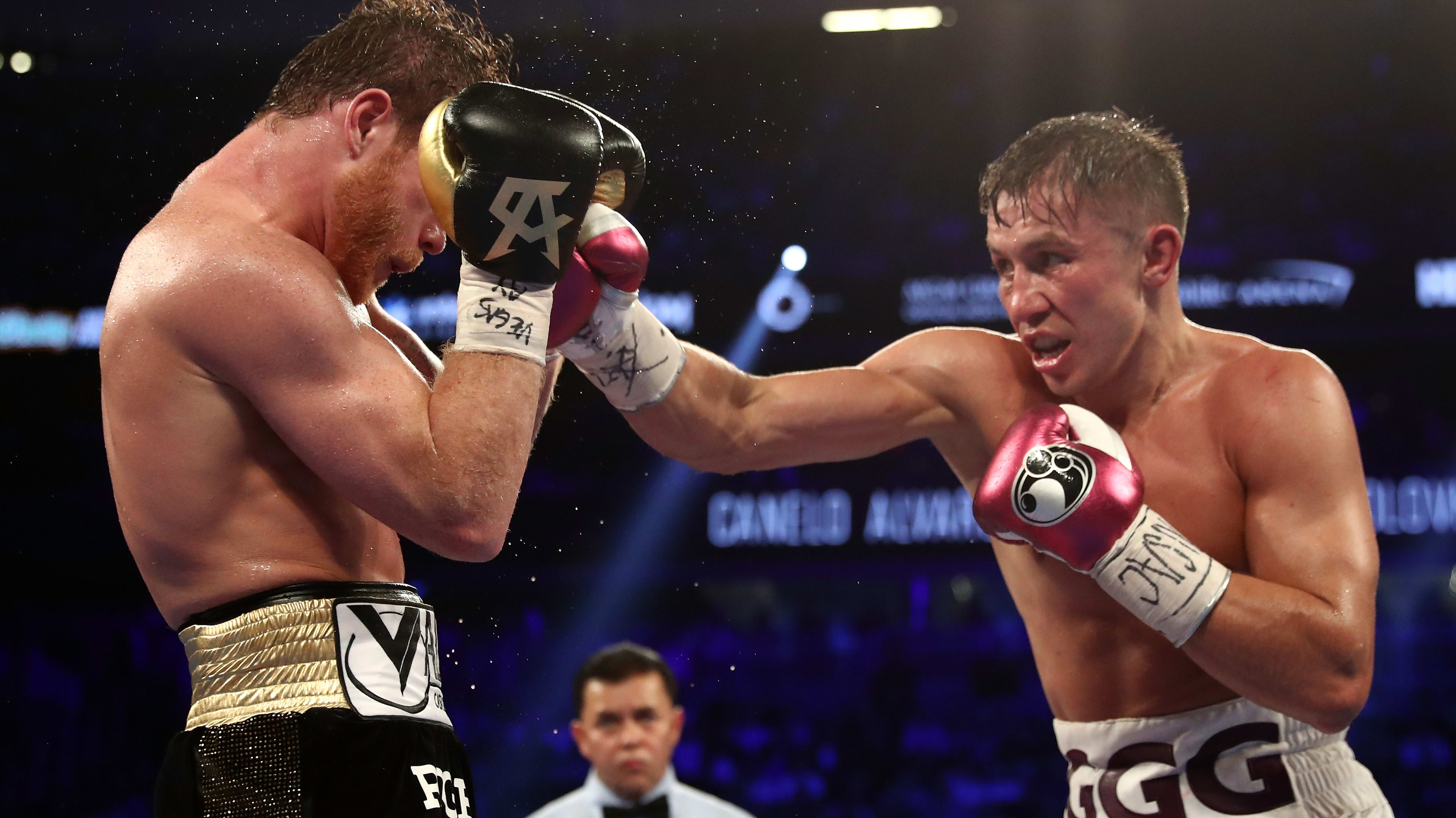 LAS VEGAS, NV - SEPTEMBER 15:  Gennady Golovkin (R) punches Canelo Alvarez during their WBC/WBA middleweight title fight at T-Mobile Arena on September 15, 2018 in Las Vegas, Nevada.  (Photo by Al Bello/Getty Images)