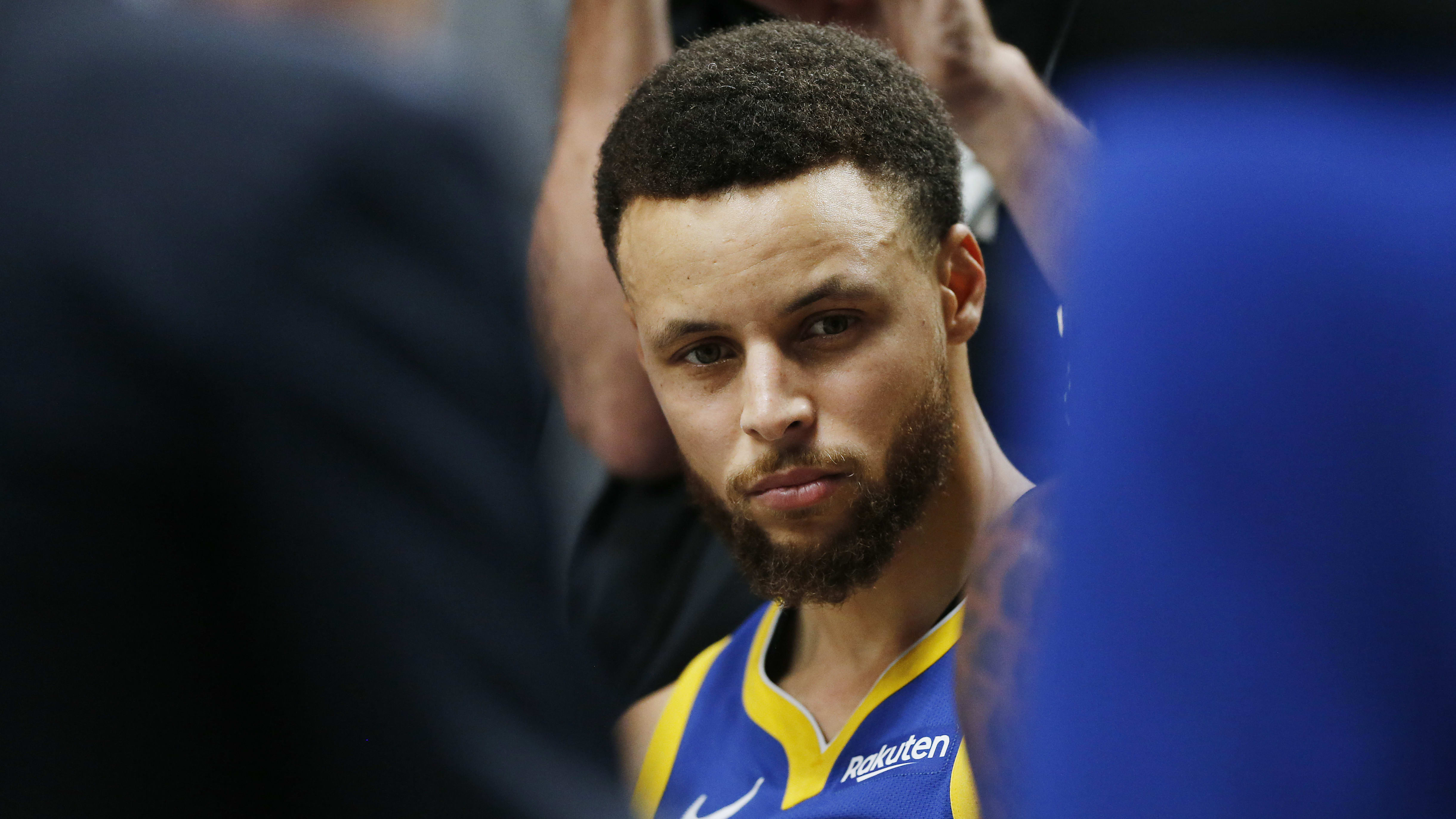 PORTLAND, OREGON - MAY 20: Stephen Curry #30 of the Golden State Warriors looks on during a timeout in game four of the NBA Western Conference Finals against the Portland Trail Blazers at Moda Center on May 20, 2019 in Portland, Oregon. NOTE TO USER: User expressly acknowledges and agrees that, by downloading and or using this photograph, User is consenting to the terms and conditions of the Getty Images License Agreement. (Photo by Jonathan Ferrey/Getty Images)