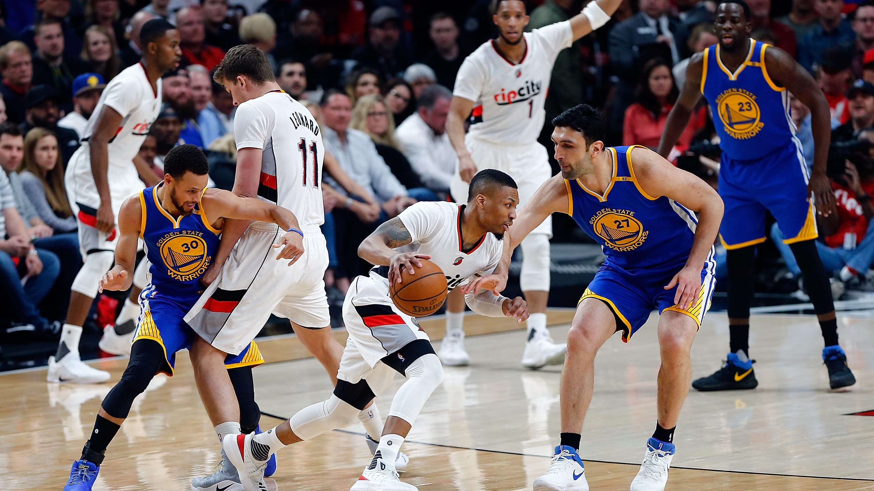 PORTLAND, OR - APRIL 24:  Damian Lillard #0 of the Portland Trail Blazers drives against the Golden State Warriors during Game Four of the Western Conference Quarterfinals of  the 2017 NBA Playoffs at Moda Center on April 24, 2017 in Portland, Oregon.  NOTE TO USER: User expressly acknowledges and agrees that, by downloading and or using this photograph, User is consenting to the terms and conditions of the Getty Images License Agreement.  (Photo by Jonathan Ferrey/Getty Images)
