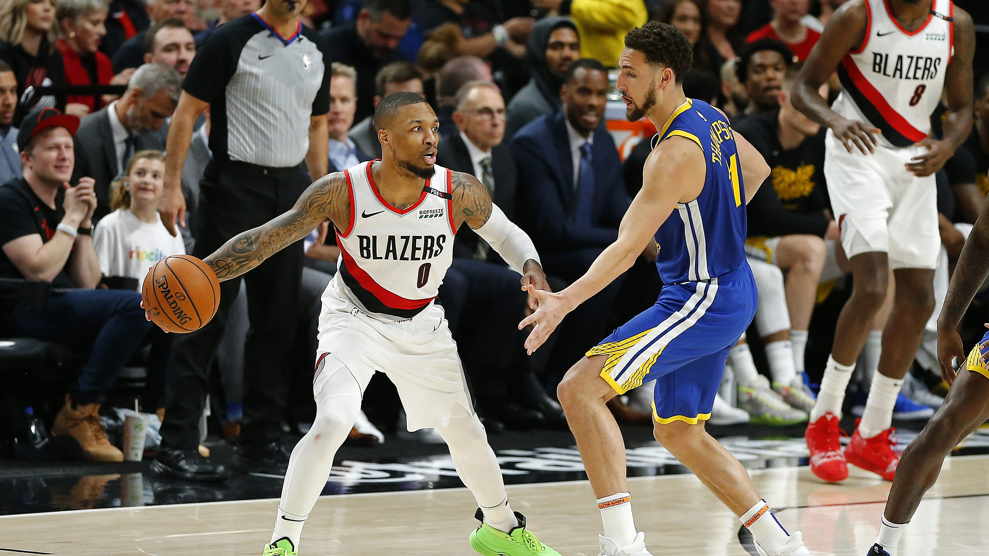 PORTLAND, OREGON - MAY 18: Damian Lillard #0 of the Portland Trail Blazers dribbles against Klay Thompson #11 of the Golden State Warriors in game three of the NBA Western Conference Finals at Moda Center on May 18, 2019 in Portland, Oregon. NOTE TO USER: User expressly acknowledges and agrees that, by downloading and or using this photograph, User is consenting to the terms and conditions of the Getty Images License Agreement. (Photo by Jonathan Ferrey/Getty Images)