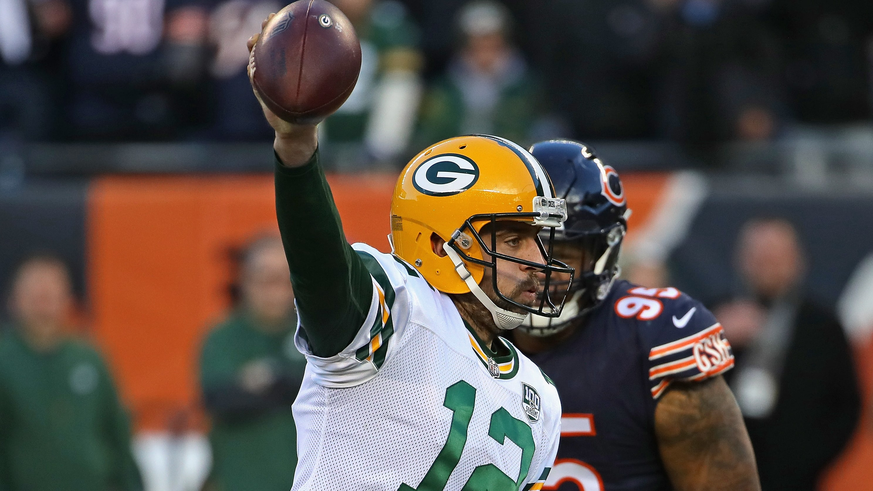 CHICAGO, IL - DECEMBER 16:  Aaron Rodgers #12 of the Green Bay Packers is pursued by Roy Robertson-Harris #95 of the Chicago Bears at Soldier Field on December 16, 2018 in Chicago, Illinois.The Bears defeated the Packers 24-17.  (Photo by Jonathan Daniel/Getty Images)