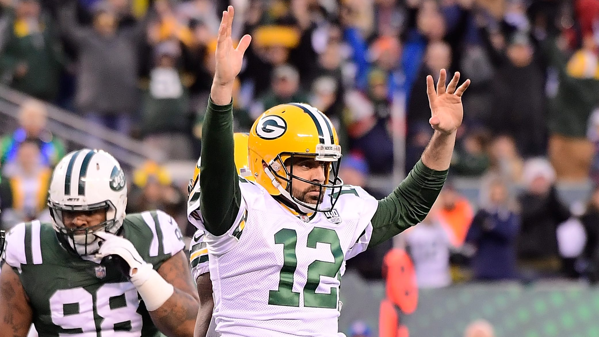EAST RUTHERFORD, NJ - DECEMBER 23: Aaron Rodgers #12 of the Green Bay Packers celebrates after scoring a 1 yard touchdown to put them ahead 38-35 against the New York Jets during the fourth quarter at MetLife Stadium on December 23, 2018 in East Rutherford, New Jersey.  (Photo by Steven Ryan/Getty Images)
