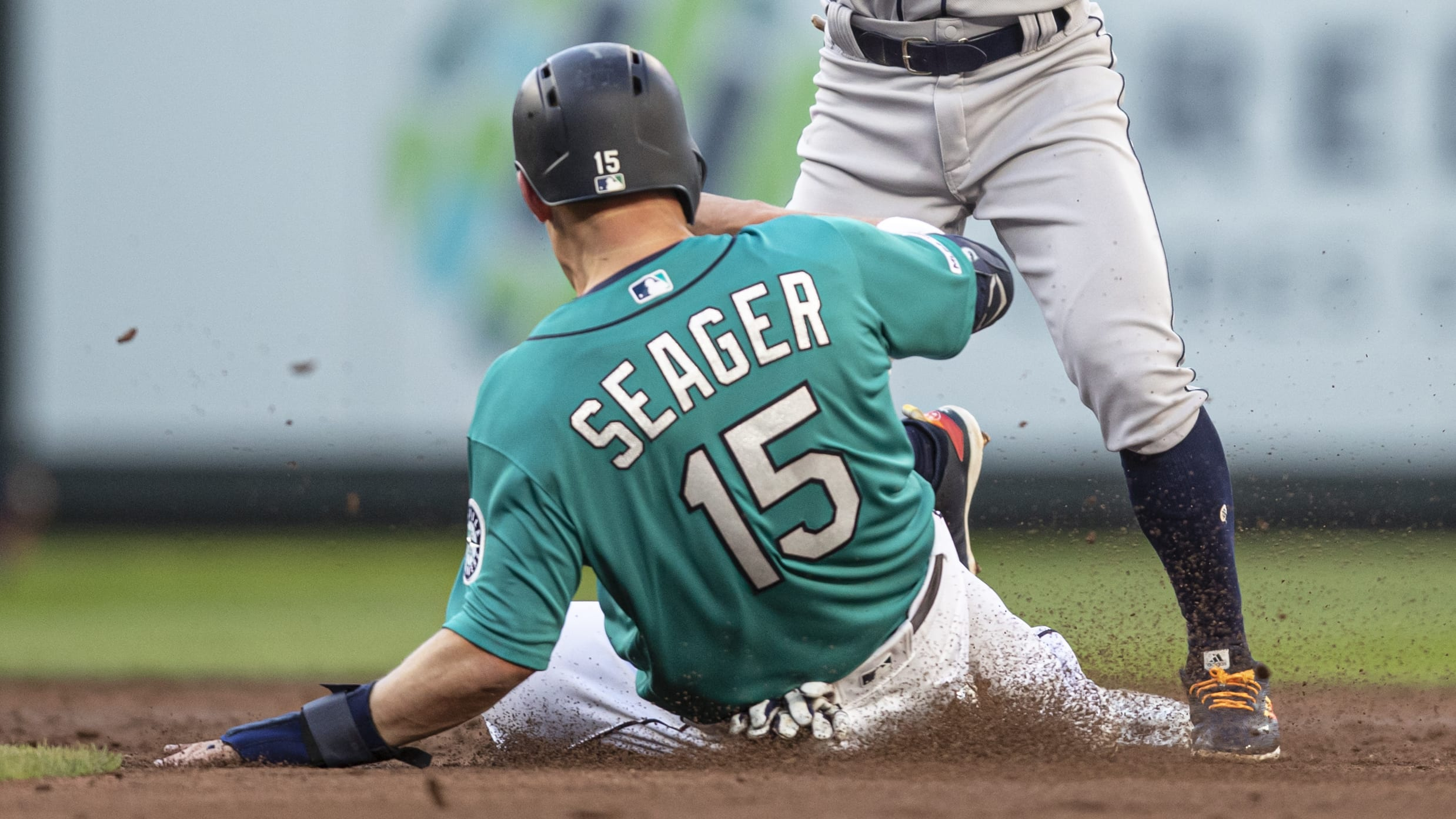 SEATTLE, WA - JUNE 5: Second baseman Tony Kemp #18 of the Houston Astros turns a double play after forcing out Kyle Seager #15 of the Seattle Mariners at second base on a ball hit by Domingo Santana #16 of the Seattle Mariners during the second inning of a game at T-Mobile Park on June 5, 2019 in Seattle, Washington. (Photo by Stephen Brashear/Getty Images)
