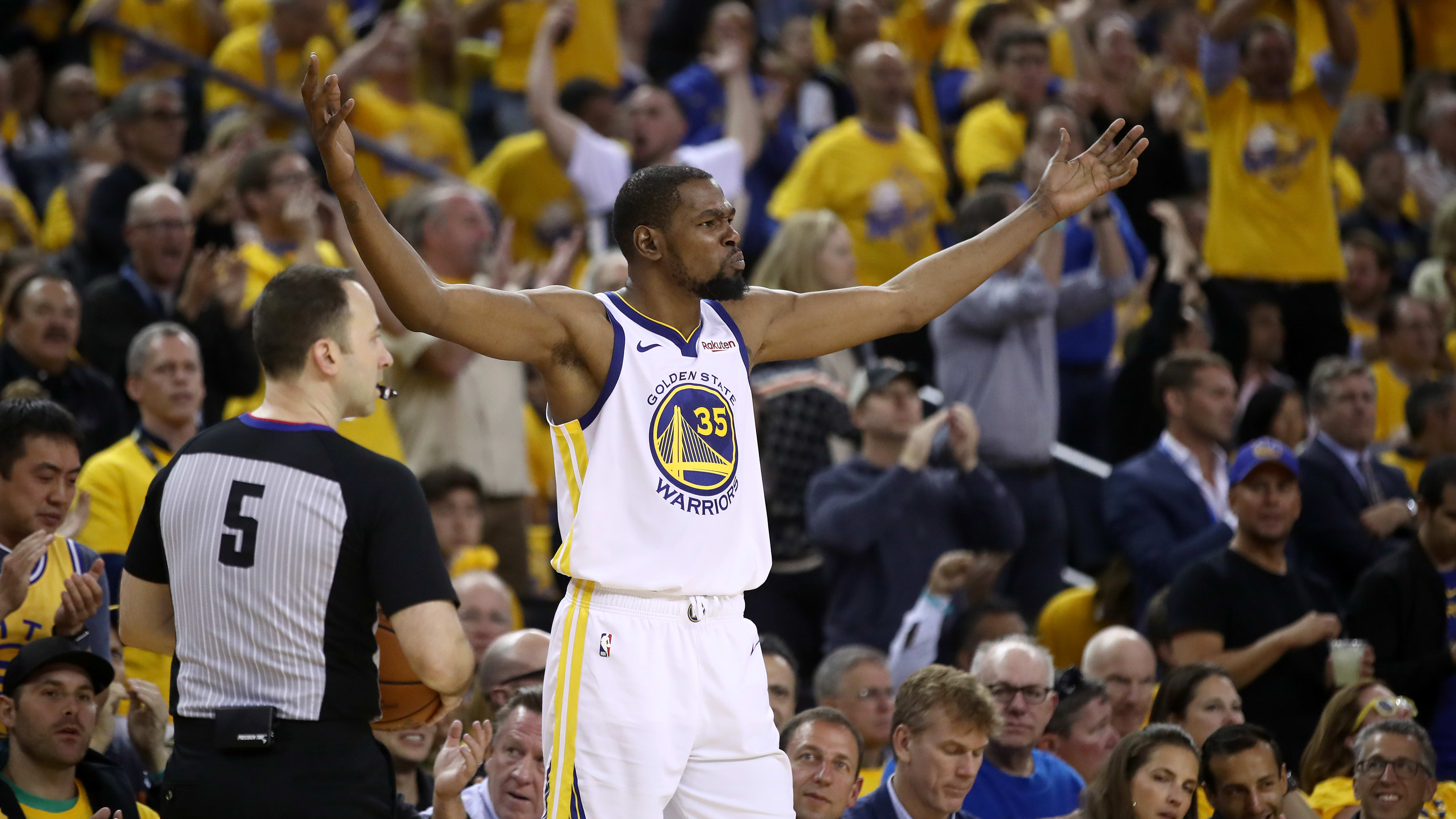 OAKLAND, CALIFORNIA - MAY 08:   Kevin Durant #35 of the Golden State Warriors reacts before taking the ball out of bounds against the Houston Rockets during Game Five of the Western Conference Semifinals of the 2019 NBA Playoffs at ORACLE Arena on May 08, 2019 in Oakland, California.  NOTE TO USER: User expressly acknowledges and agrees that, by downloading and or using this photograph, User is consenting to the terms and conditions of the Getty Images License Agreement.  (Photo by Ezra Shaw/Getty Images)