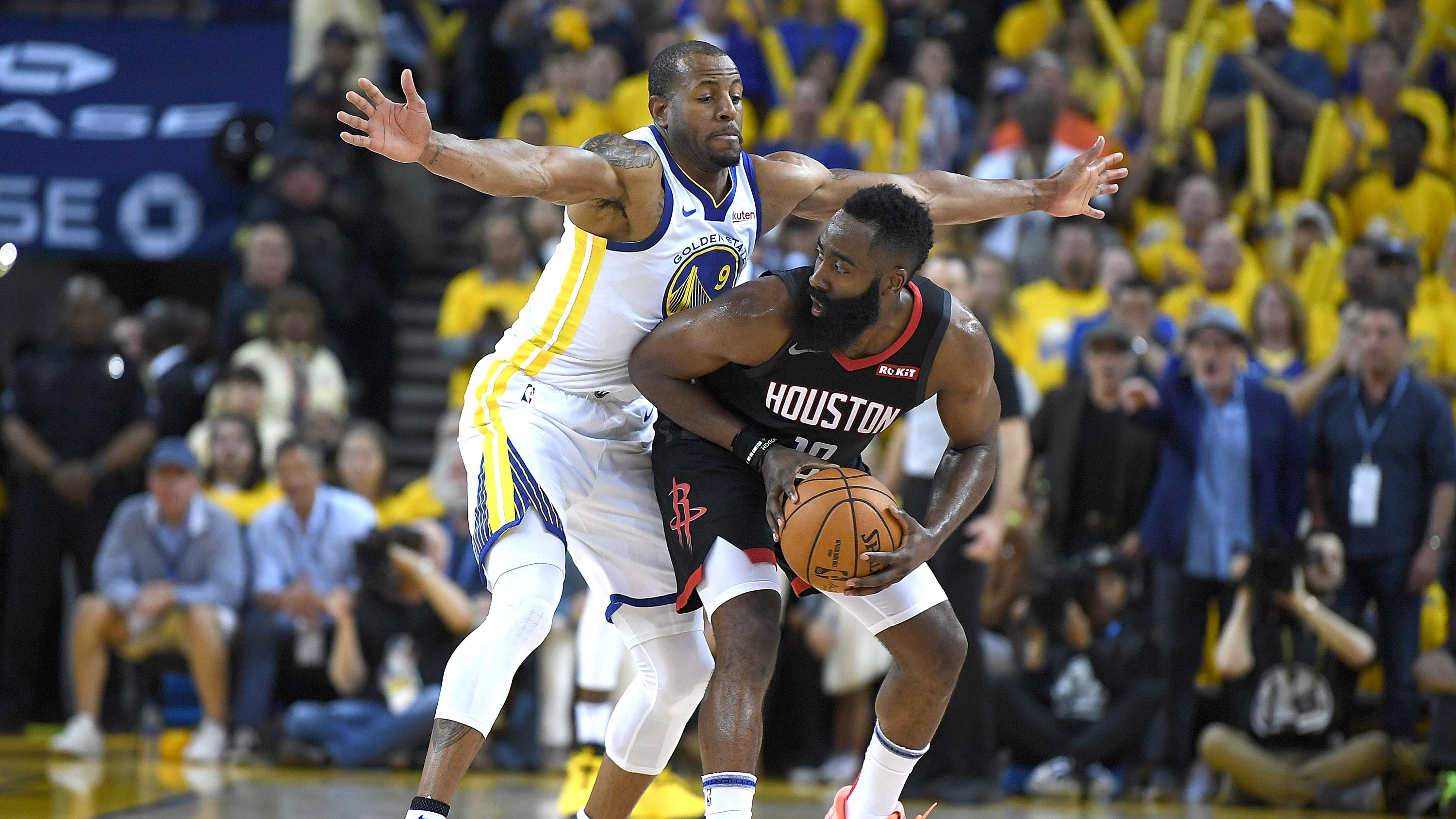 OAKLAND, CA - APRIL 28:  Andre Iguodala #9 of the Golden State Warriors closely guards James Harden #13 of the Houston Rockets during Game One of the Second Round of the 2019 NBA Western Conference Playoffs at ORACLE Arena on April 28, 2019 in Oakland, California. NOTE TO USER: User expressly acknowledges and agrees that, by downloading and or using this photograph, User is consenting to the terms and conditions of the Getty Images License Agreement.  (Photo by Thearon W. Henderson/Getty Images)