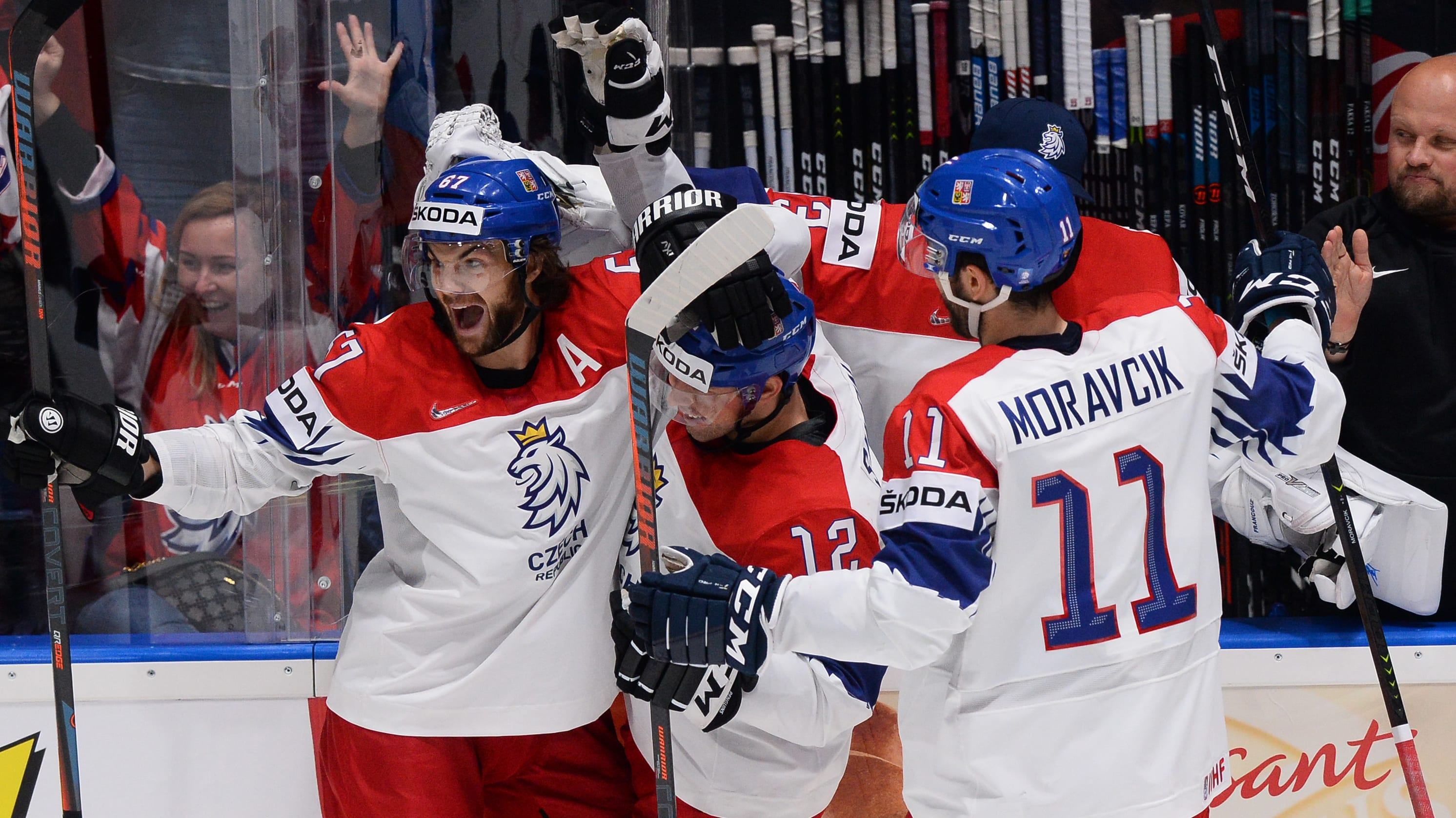 Czech players celebrate a scoring during the IIHF Men's Ice Hockey World Championships Group B match between the Czech Republic and Switzerland on May 21, 2019 in Bratislava. (Photo by VLADIMIR SIMICEK / AFP)        (Photo credit should read VLADIMIR SIMICEK/AFP/Getty Images)