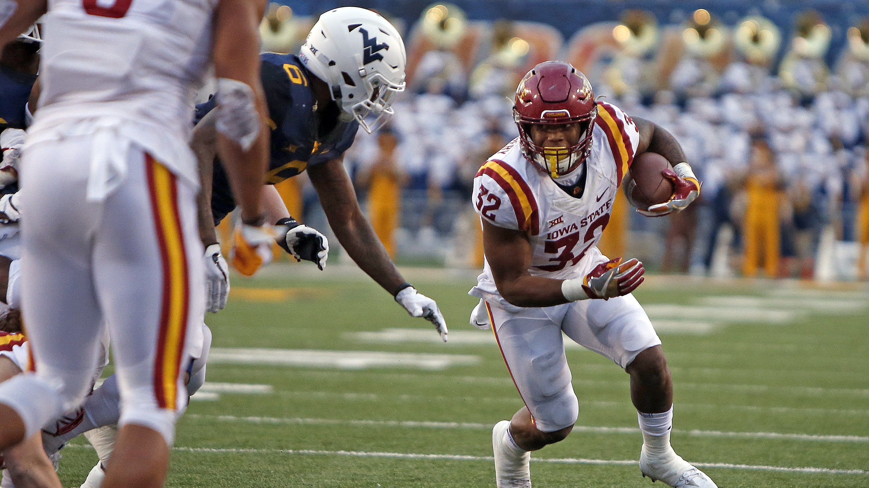 MORGANTOWN, WV - NOVEMBER 04: David Montgomery #32 of the Iowa State Cyclones rushes against the West Virginia Mountaineers at Mountaineer Field on November 04, 2017 in Morgantown, West Virginia. (Photo by Justin K. Aller/Getty Images)