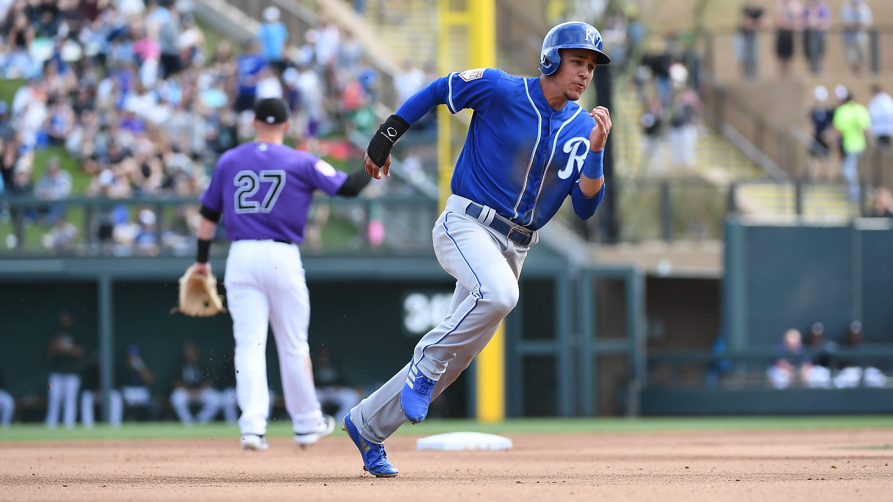 SCOTTSDALE, AZ - MARCH 15:  Nicky Lopez #9 of the Kansas City Royals advances to third base on a double by Chris Owings #2 during the fourth inning of a spring training game against the Colorado Rockies at Salt River Fields at Talking Stick on March 15, 2019 in Scottsdale, Arizona.  (Photo by Norm Hall/Getty Images)