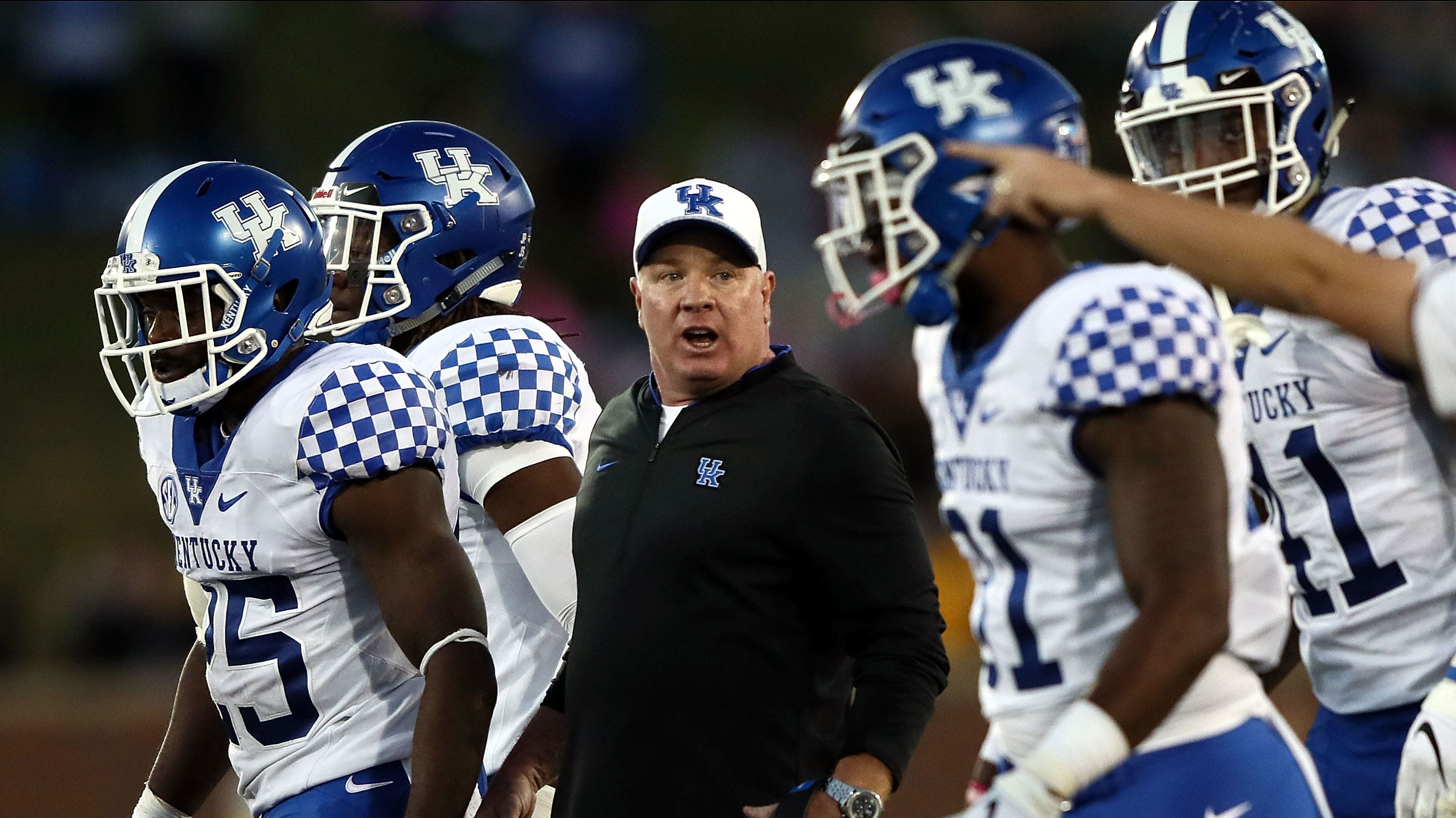 COLUMBIA, MO - OCTOBER 27:  Head coach Mark Stoops of the Kentucky Wildcats talks to players during the game against the Missouri Tigers at Faurot Field/Memorial Stadium on October 27, 2018 in Columbia, Missouri.  (Photo by Jamie Squire/Getty Images)