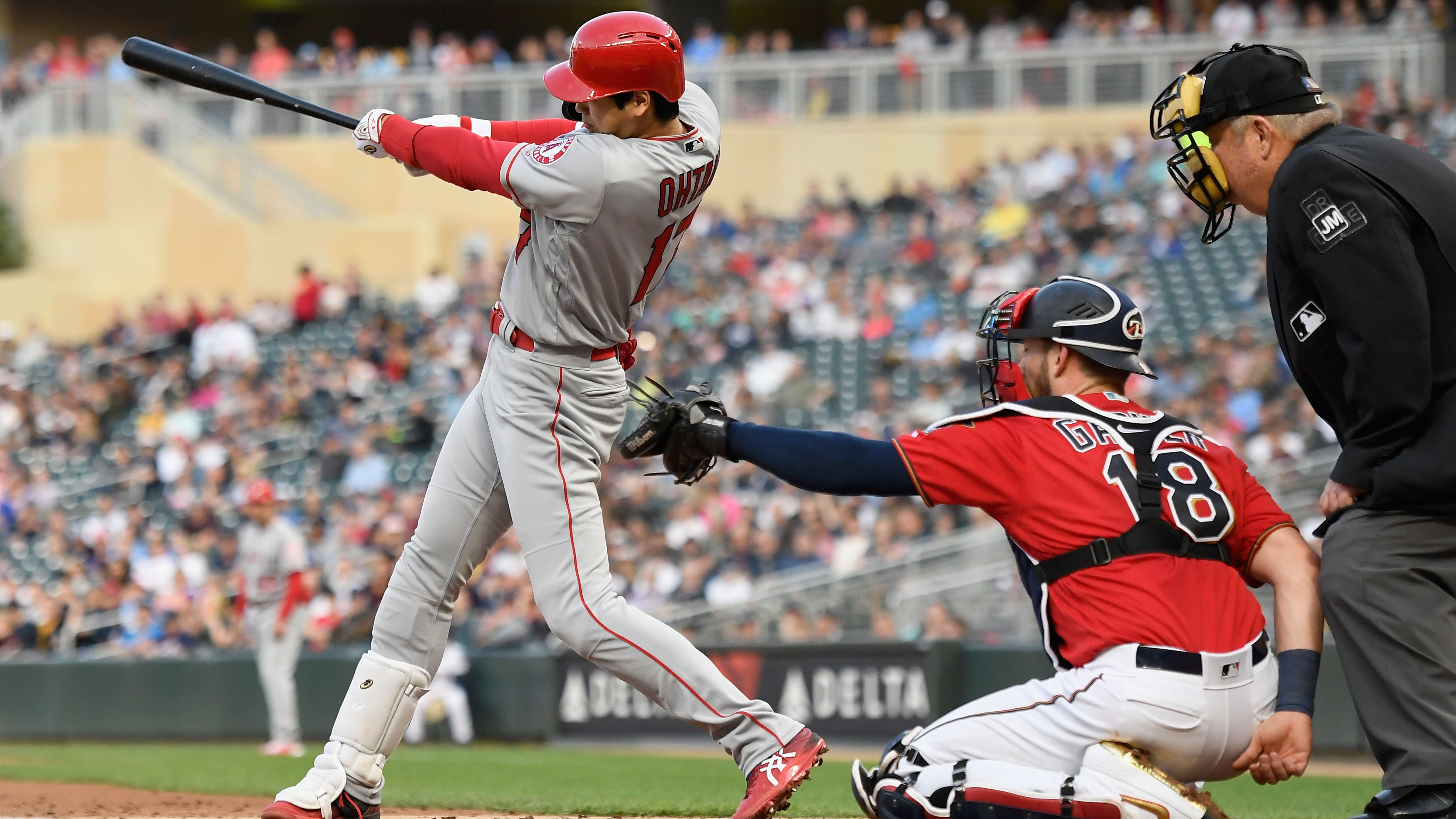 MINNEAPOLIS, MN - MAY 14: Shohei Ohtani #17 of the Los Angeles Angels of Anaheim hits a single as Mitch Garver #18 of the Minnesota Twins catches during the fourth inning of the game on May 14, 2019 at Target Field in Minneapolis, Minnesota. (Photo by Hannah Foslien/Getty Images)