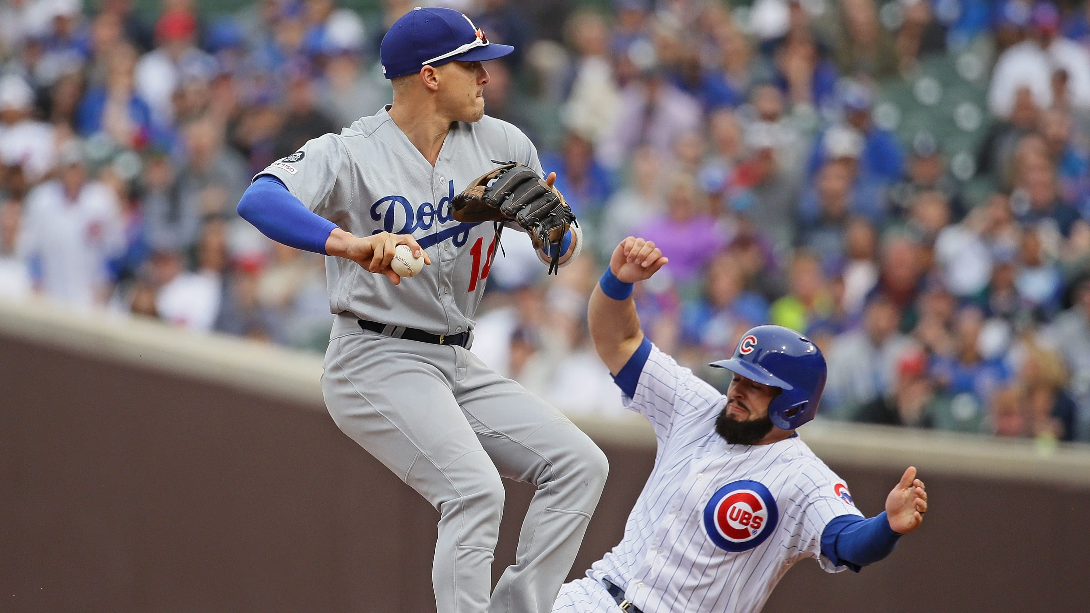 CHICAGO, ILLINOIS - APRIL 25: Enrique Hernandez #14 of the Los Angeles Dodgers turns a double play over David Bote #13 of the Chicago Cubs at Wrigley Field on April 25, 2019 in Chicago, Illinois. The Dodgers defeated the Cubs 2-1. (Photo by Jonathan Daniel/Getty Images)