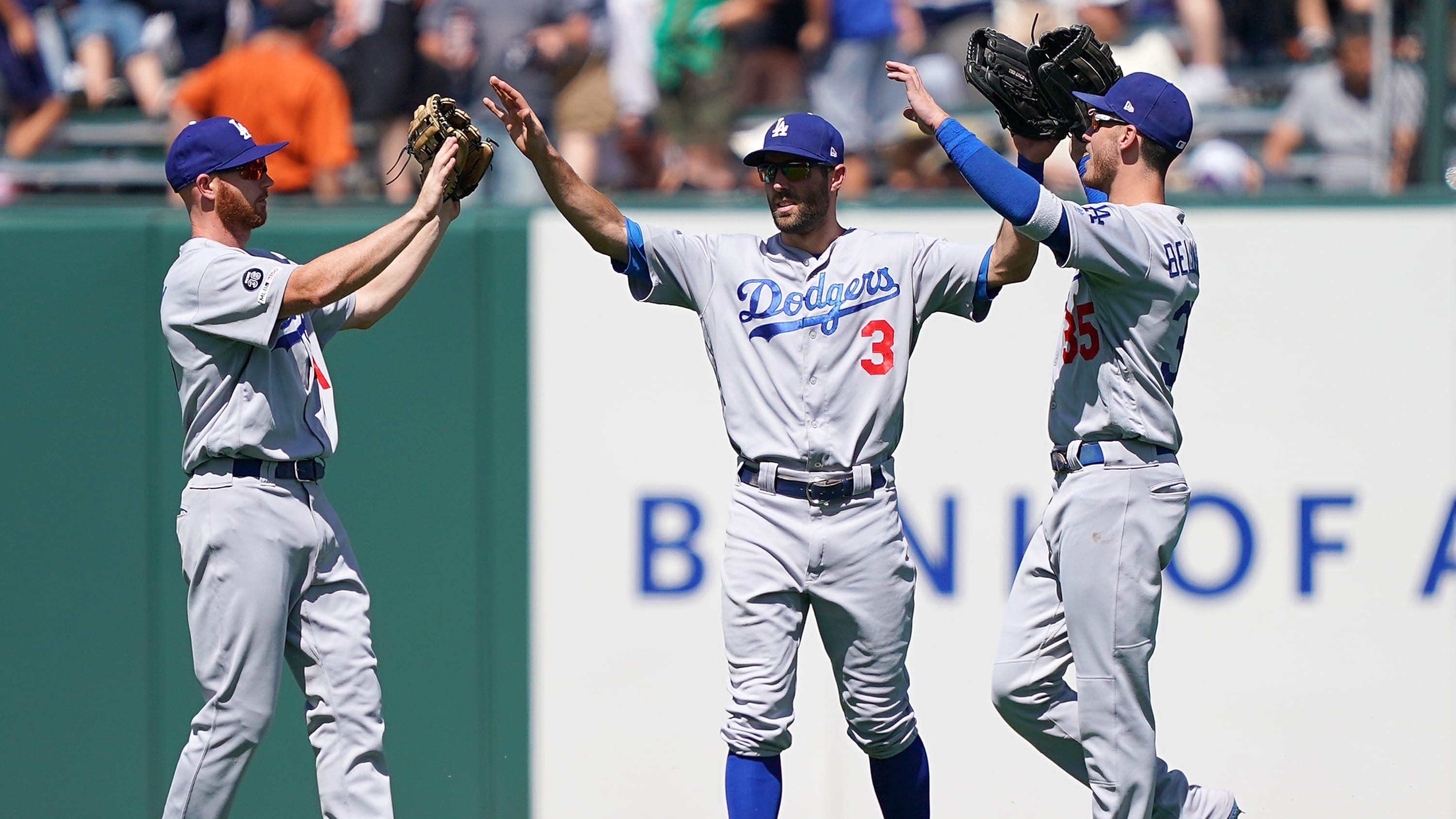 SAN FRANCISCO, CA - JUNE 09:  Kyle Garlick #41, Chris Taylor #3 and Cody Bellinger #35 of the Los Angeles Dodgers celebrates defeating the San Francisco Giants 1-0 at Oracle Park on June 9, 2019 in San Francisco, California.  (Photo by Thearon W. Henderson/Getty Images)