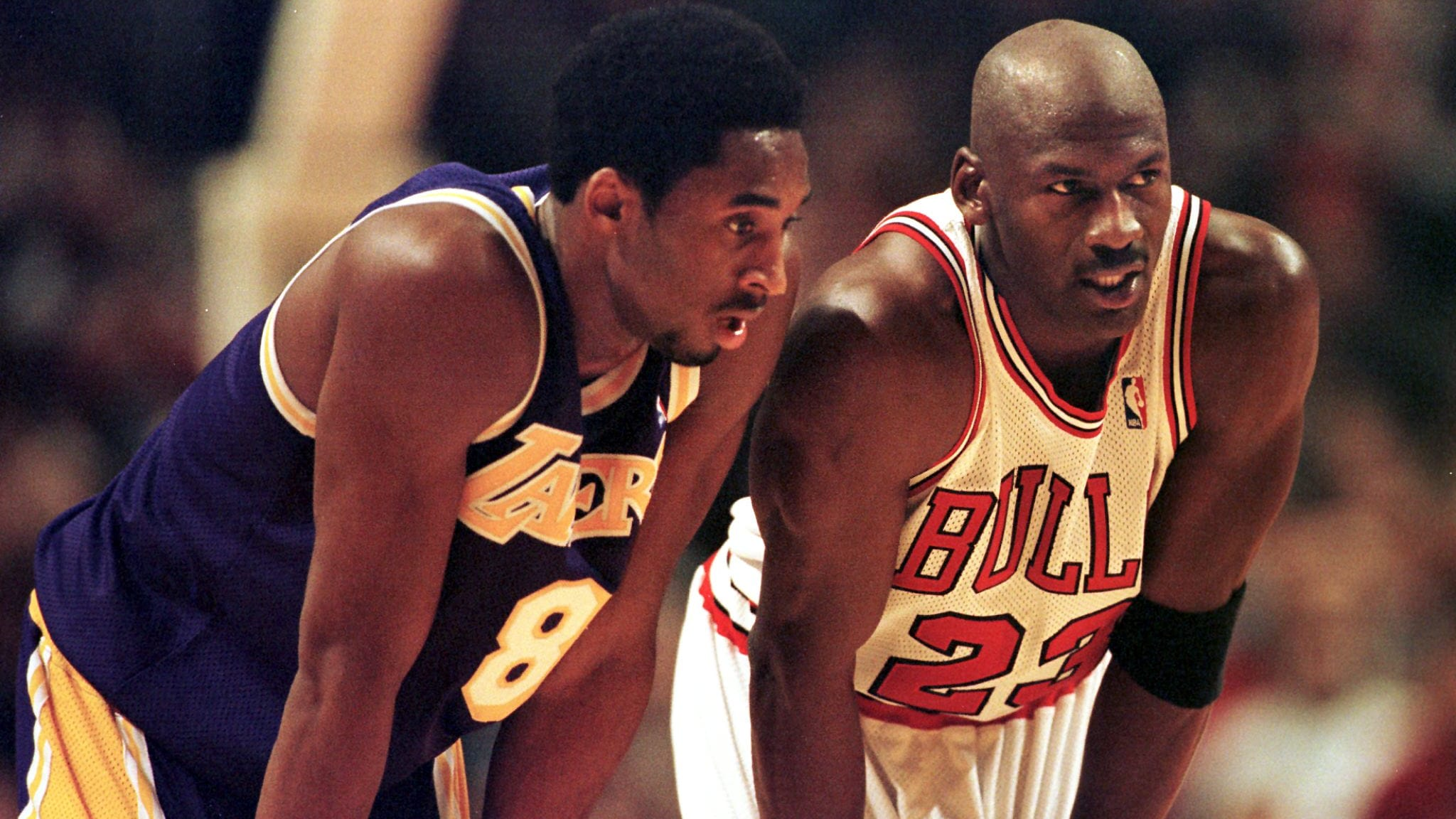 CHICAGO, UNITED STATES:  Los Angeles Lakers guard Kobe Bryant(L) and Chicago Bulls guard Michael Jordan(R) talk during a free-throw attempt during the fourth quarter 17 December at the United Center in Chicago. Bryant, who is 19 and bypassed college basketball to play in the NBA, scored a team-high 33 points off the bench, and Jordan scored a team-high 36 points. The Bulls defeated the Lakers 104-83.  AFP PHOTO  VINCENT LAFORET (Photo credit should read VINCENT LAFORET/AFP/Getty Images)