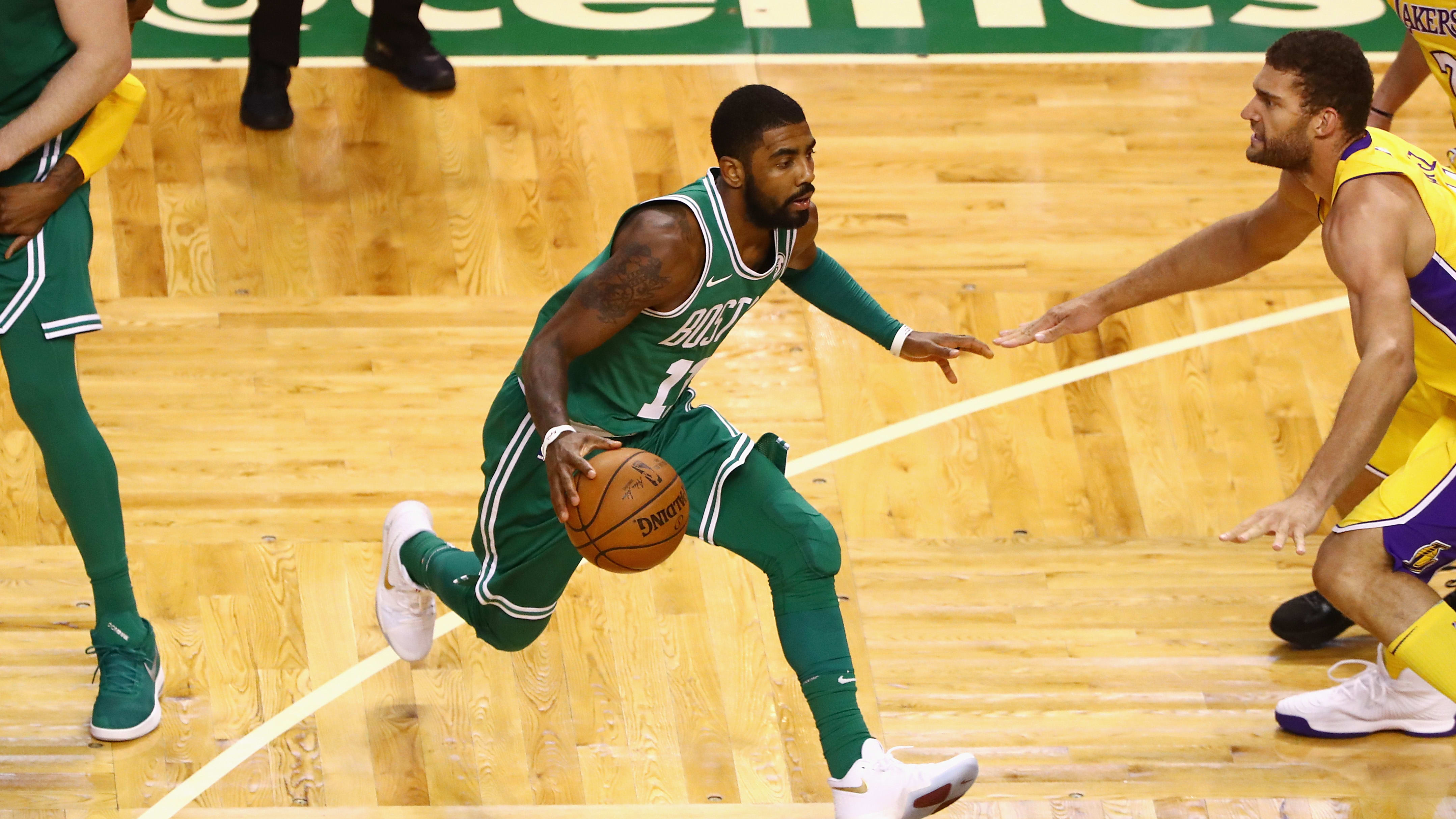 BOSTON, MA - NOVEMBER 08:  Kyrie Irving #11 of the Boston Celtics dribbles the ball during the fourth quarter against the Los Angeles Lakers at TD Garden on November 8, 2017 in Boston, Massachusetts.  (Photo by Tim Bradbury/Getty Images)