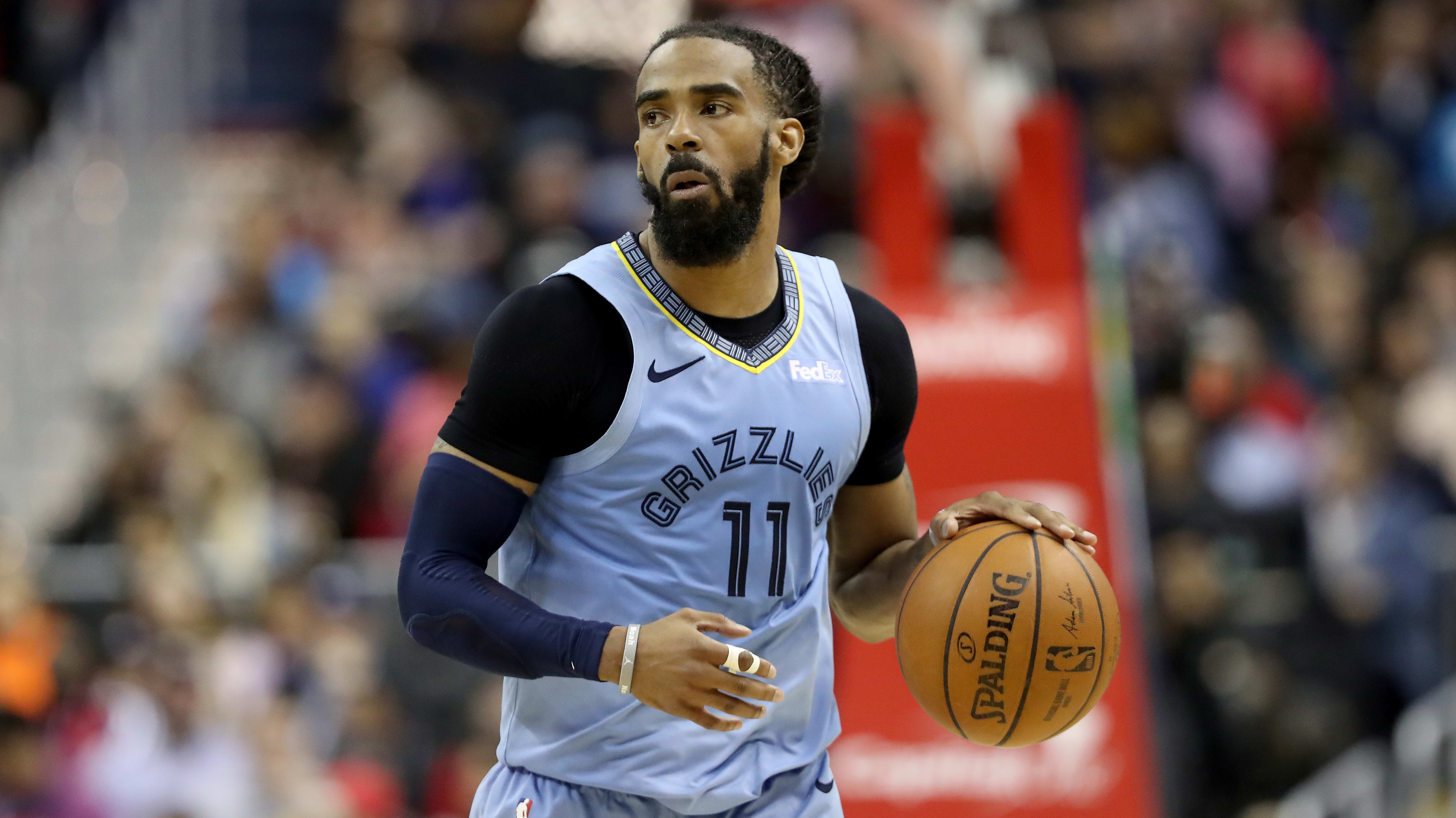 WASHINGTON, DC - MARCH 16: Mike Conley #11 of the Memphis Grizzlies dribbles the ball against the Washington Wizards in the second half  at Capital One Arena on March 16, 2019 in Washington, DC. NOTE TO USER: User expressly acknowledges and agrees that, by downloading and or using this photograph, User is consenting to the terms and conditions of the Getty Images License Agreement. (Photo by Rob Carr/Getty Images)