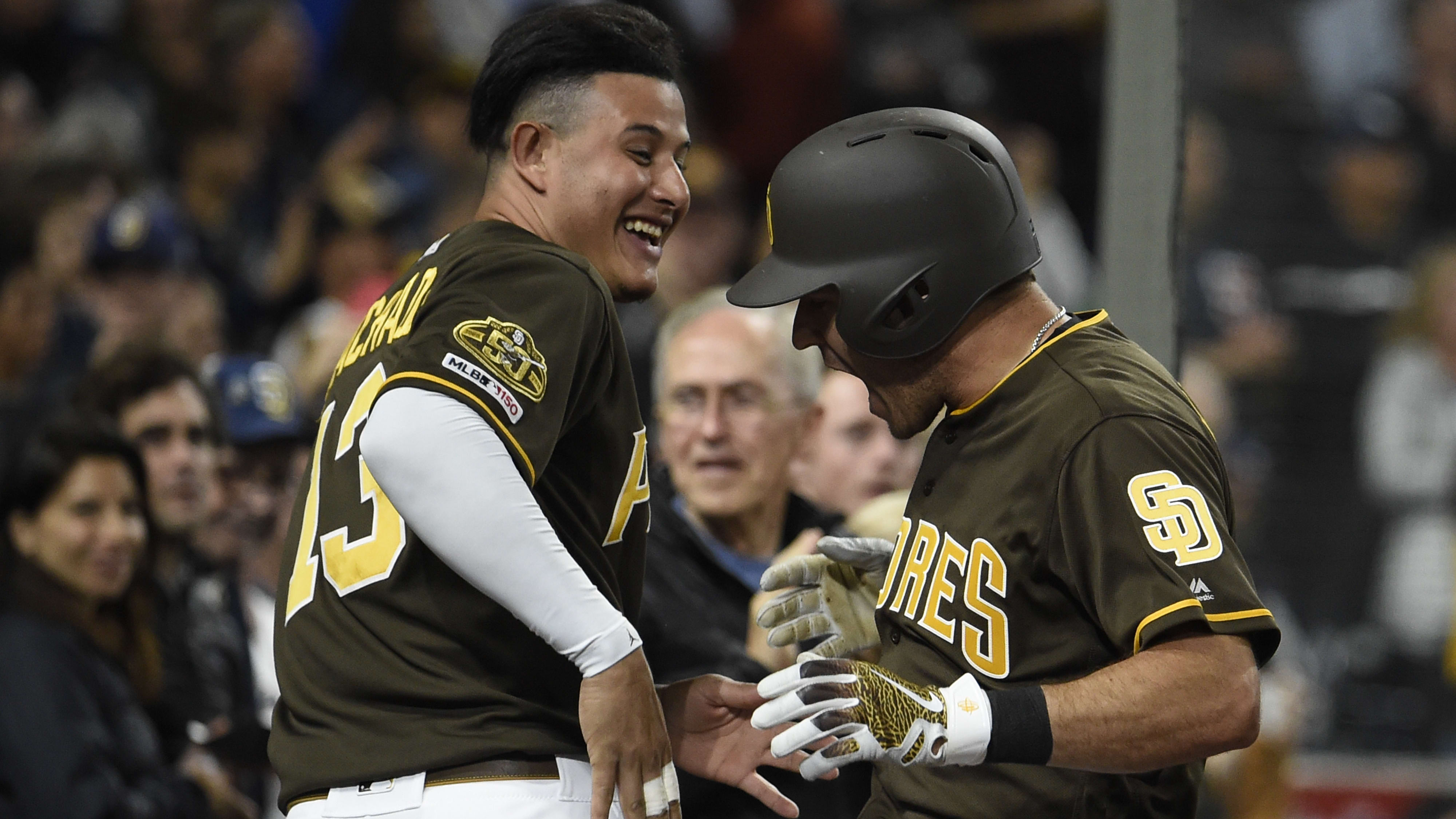 SAN DIEGO, CA - MAY 31: Ian Kinsler #3 of the San Diego Padres (R) and Manny Machado #13 celebrate after Kinsler hit a solo home run during the seventh inning of a baseball game against the Miami Marlins at Petco Park May 31, 2019 in San Diego, California.  (Photo by Denis Poroy/Getty Images)
