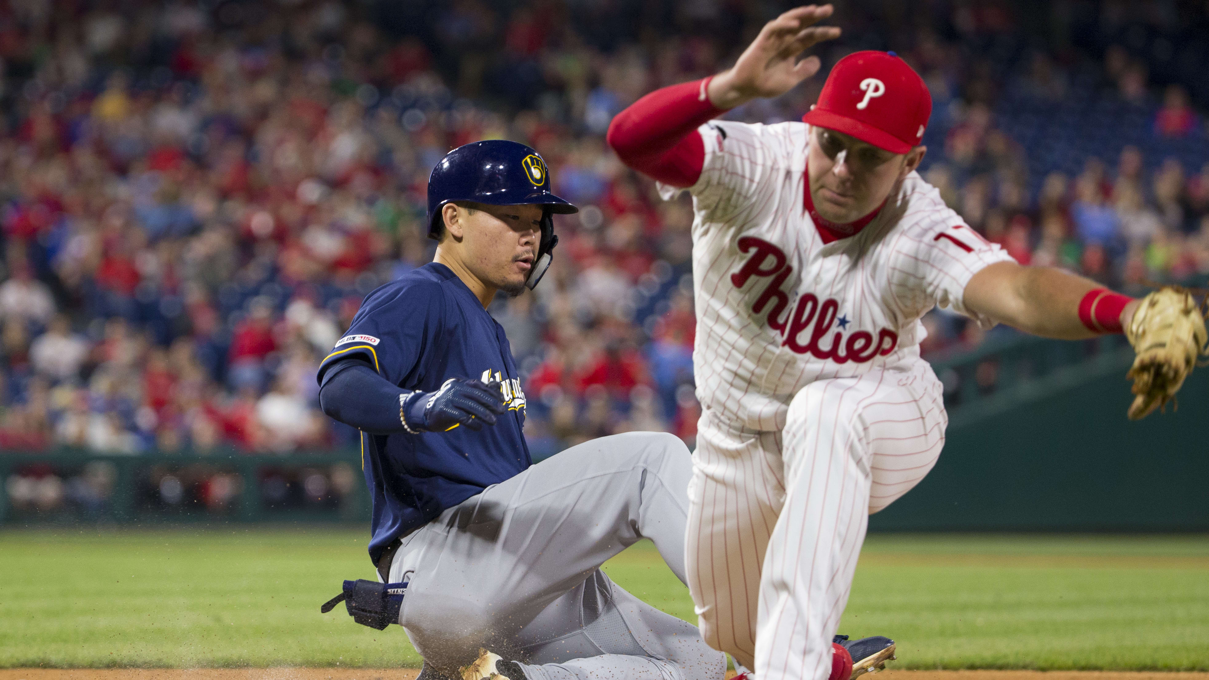 PHILADELPHIA, PA - MAY 15: Rhys Hoskins #17 of the Philadelphia Phillies forces out Keston Hiura #18 of the Milwaukee Brewers as he attempts to slide into first base in the top of the fifth inning at Citizens Bank Park on May 15, 2019 in Philadelphia, Pennsylvania. The Brewers defeated the Phillies 5-2. (Photo by Mitchell Leff/Getty Images)