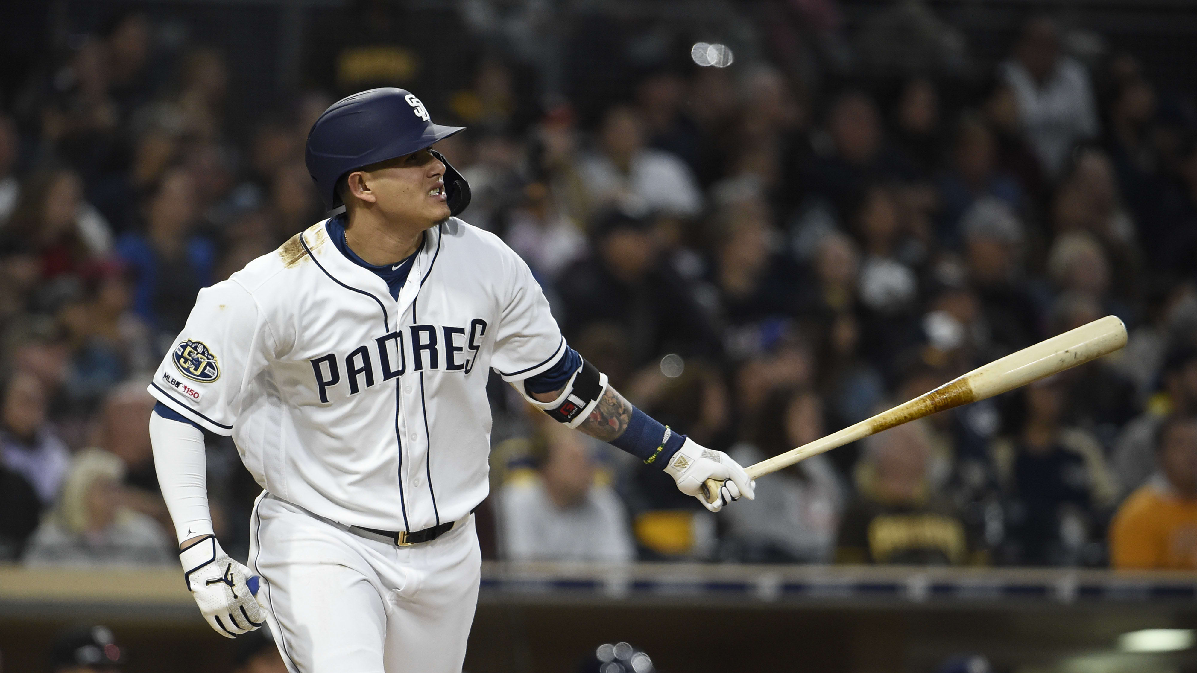 SAN DIEGO, CA - JUNE 17: Manny Machado #13 of the San Diego Padres hits a solo home run during the third inning of a baseball game against the Milwaukee Brewers at Petco Park June 17, 2019 in San Diego, California.  (Photo by Denis Poroy/Getty Images)