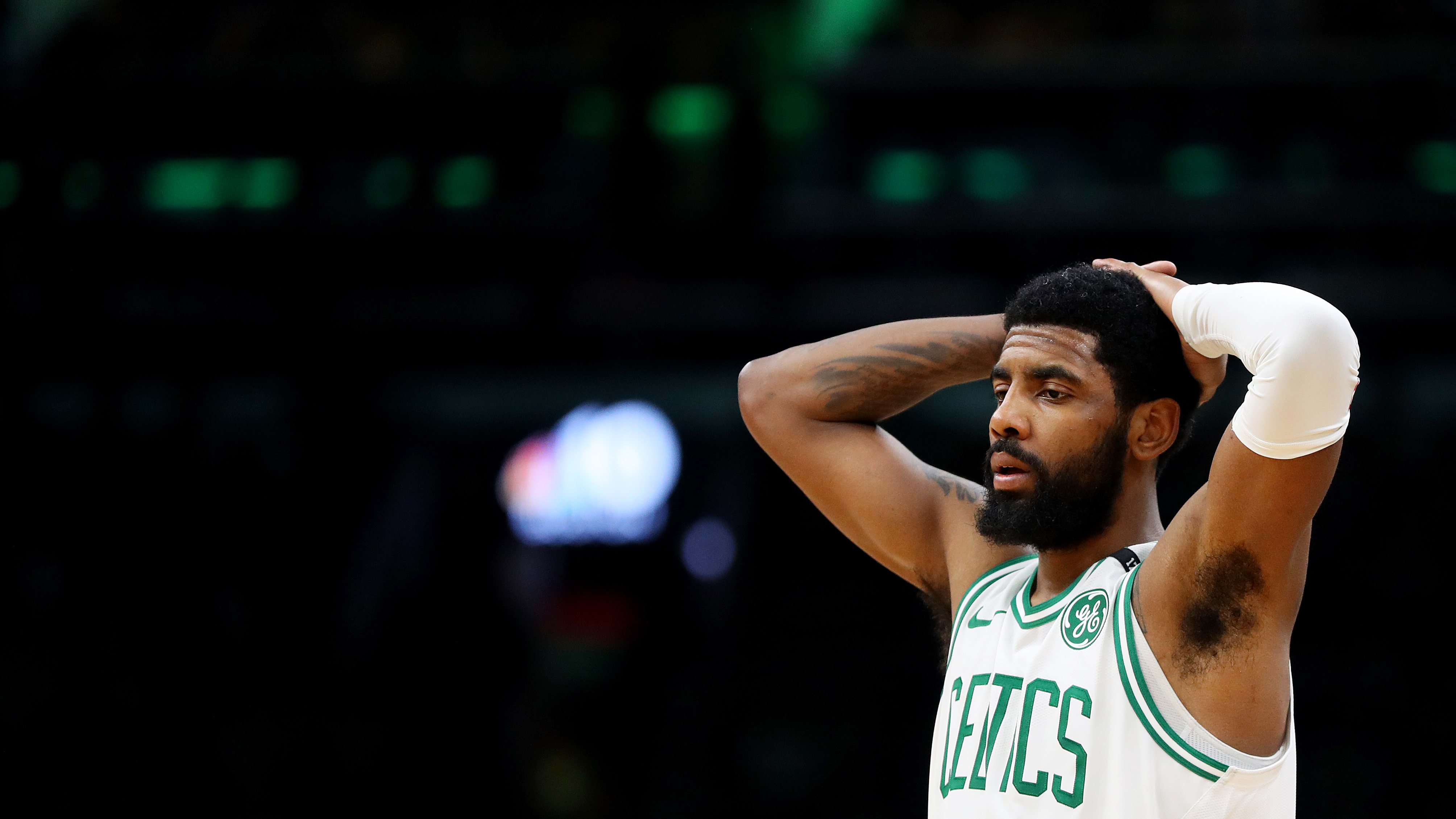 BOSTON, MASSACHUSETTS - MAY 03: Kyrie Irving #11 of the Boston Celtics reacts during the second half of Game 3 of the Eastern Conference Semifinals against the Milwaukee Bucks during the 2019 NBA Playoffs at TD Garden on May 03, 2019 in Boston, Massachusetts. The Bucks defeat the Celtics 123 - 116.  (Photo by Maddie Meyer/Getty Images)