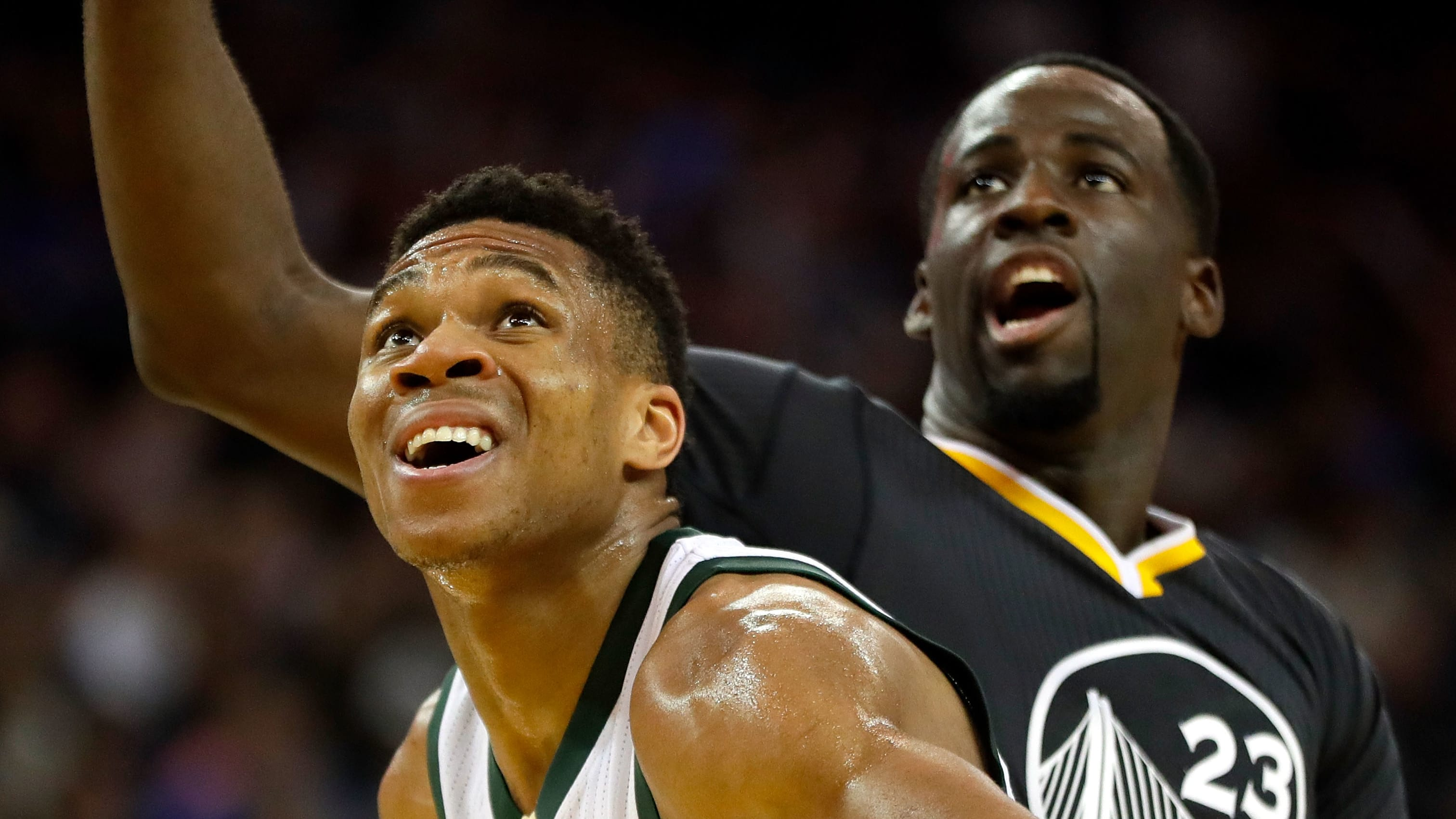 OAKLAND, CA - MARCH 18:  Giannis Antetokounmpo #34 of the Milwaukee Bucks and Draymond Green #23 of the Golden State Warriors box out during a free throw during the game at ORACLE Arena on March 18, 2017 in Oakland, California.  (Photo by Jamie Squire/Getty Images)
