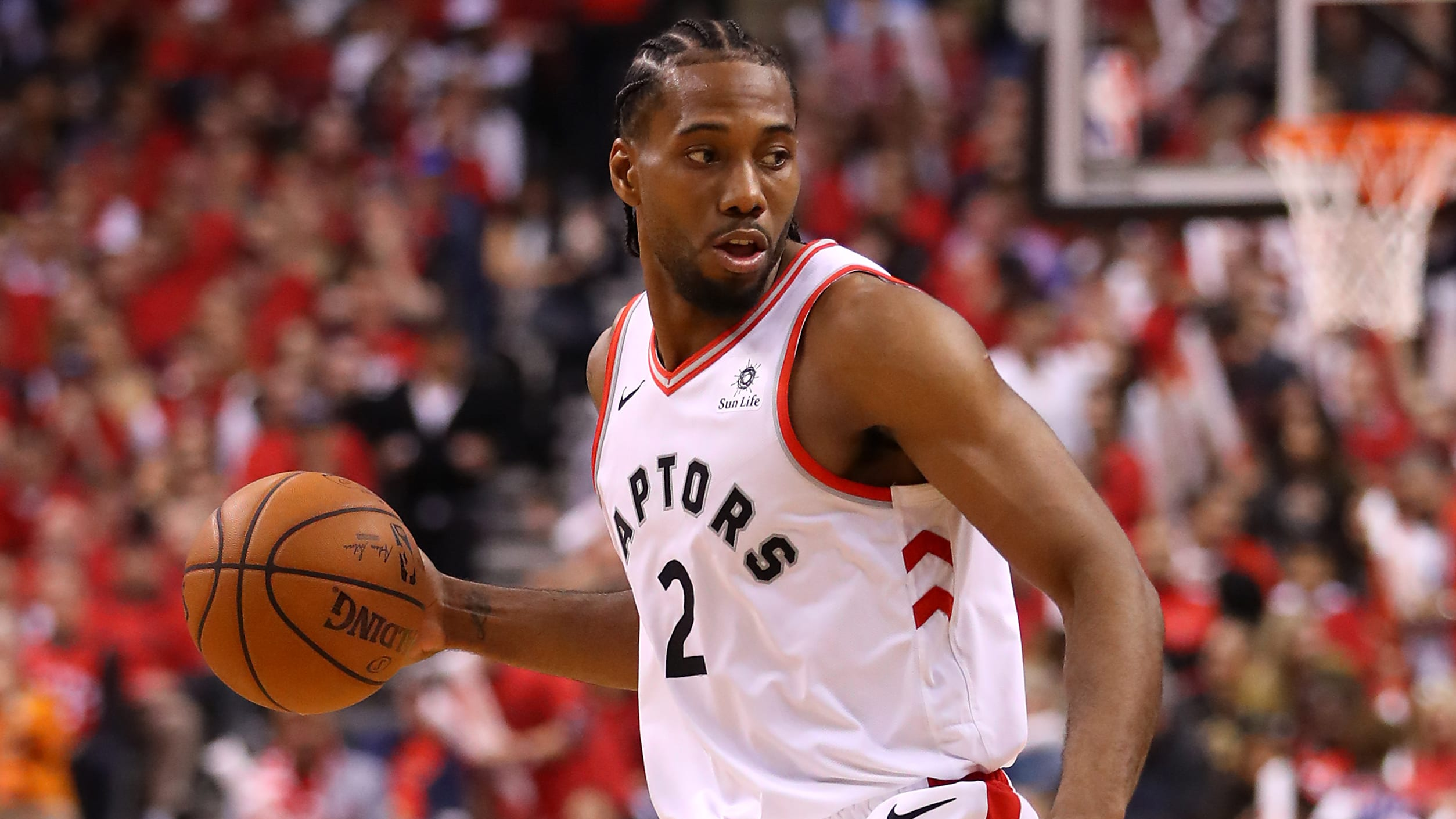 TORONTO, ONTARIO - MAY 19: Kawhi Leonard #2 of the Toronto Raptors handles the ball during the second half against the Milwaukee Bucks in game three of the NBA Eastern Conference Finals at Scotiabank Arena on May 19, 2019 in Toronto, Canada. NOTE TO USER: User expressly acknowledges and agrees that, by downloading and or using this photograph, User is consenting to the terms and conditions of the Getty Images License Agreement. (Photo by Gregory Shamus/Getty Images)