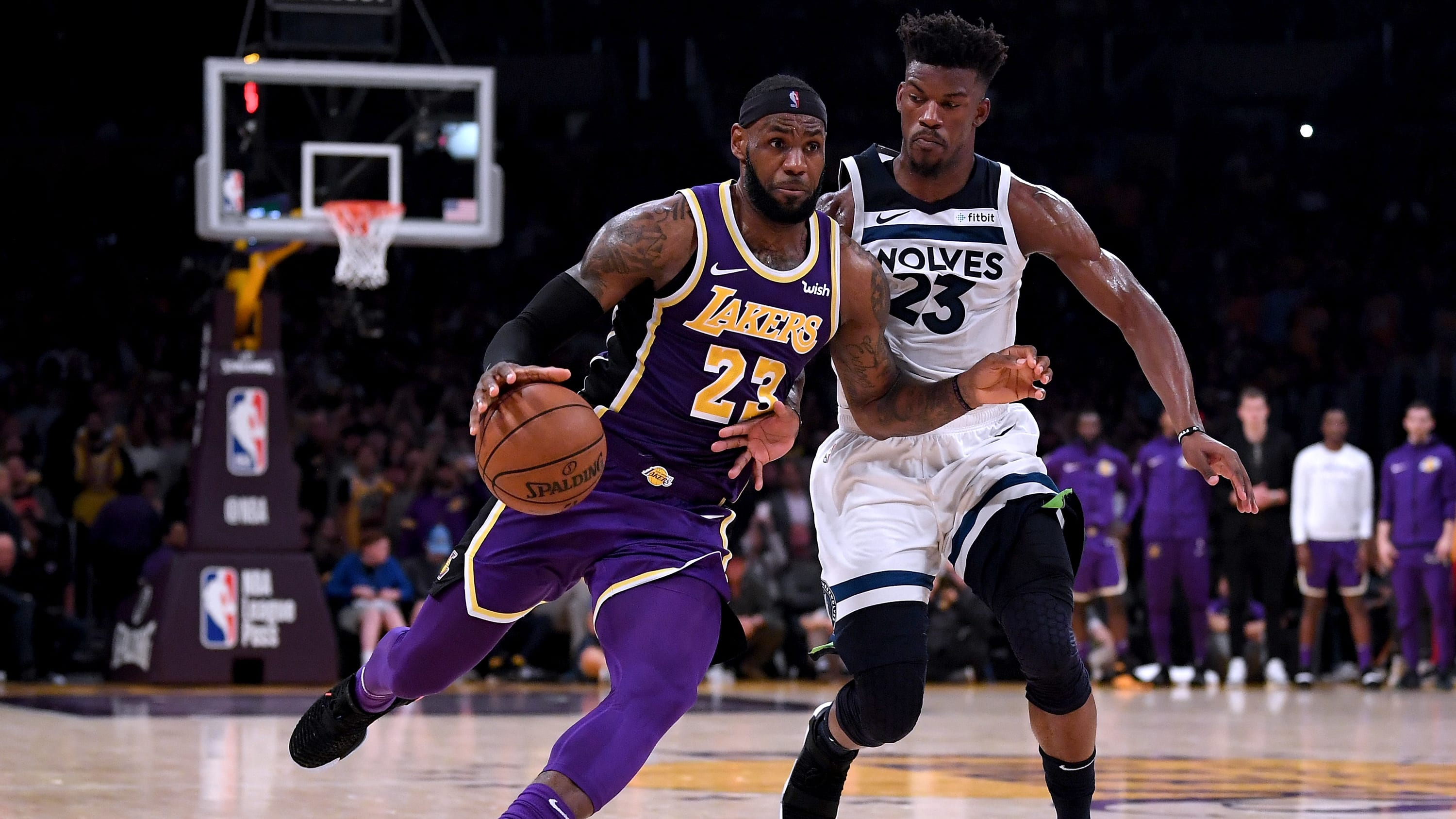 LOS ANGELES, CA - NOVEMBER 07:  LeBron James #23 of the Los Angeles Lakers drives to the basket past Jimmy Butler #23 of the Minnesota Timberwolves during a 114-110 Lakers win at Staples Center on November 7, 2018 in Los Angeles, California.  NOTE TO USER: User expressly acknowledges and agrees that, by downloading and or using this photograph, User is consenting to the terms and conditions of the Getty Images License Agreement.  (Photo by Harry How/Getty Images)