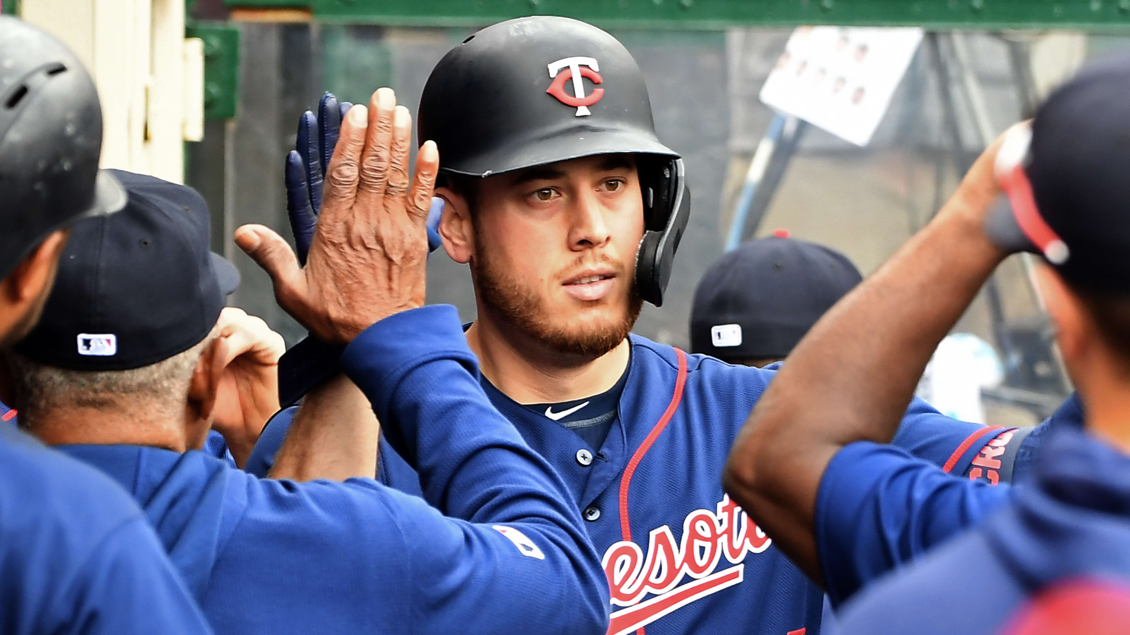 ANAHEIM, CA - MAY 23: C.J. Cron #24 of the Minnesota Twins is congratulated in the dugout after hitting a solo home run in the third inning against the Los Angeles Angels of Anaheim at Angel Stadium of Anaheim on May 23, 2019 in Anaheim, California. (Photo by Jayne Kamin-Oncea/Getty Images)